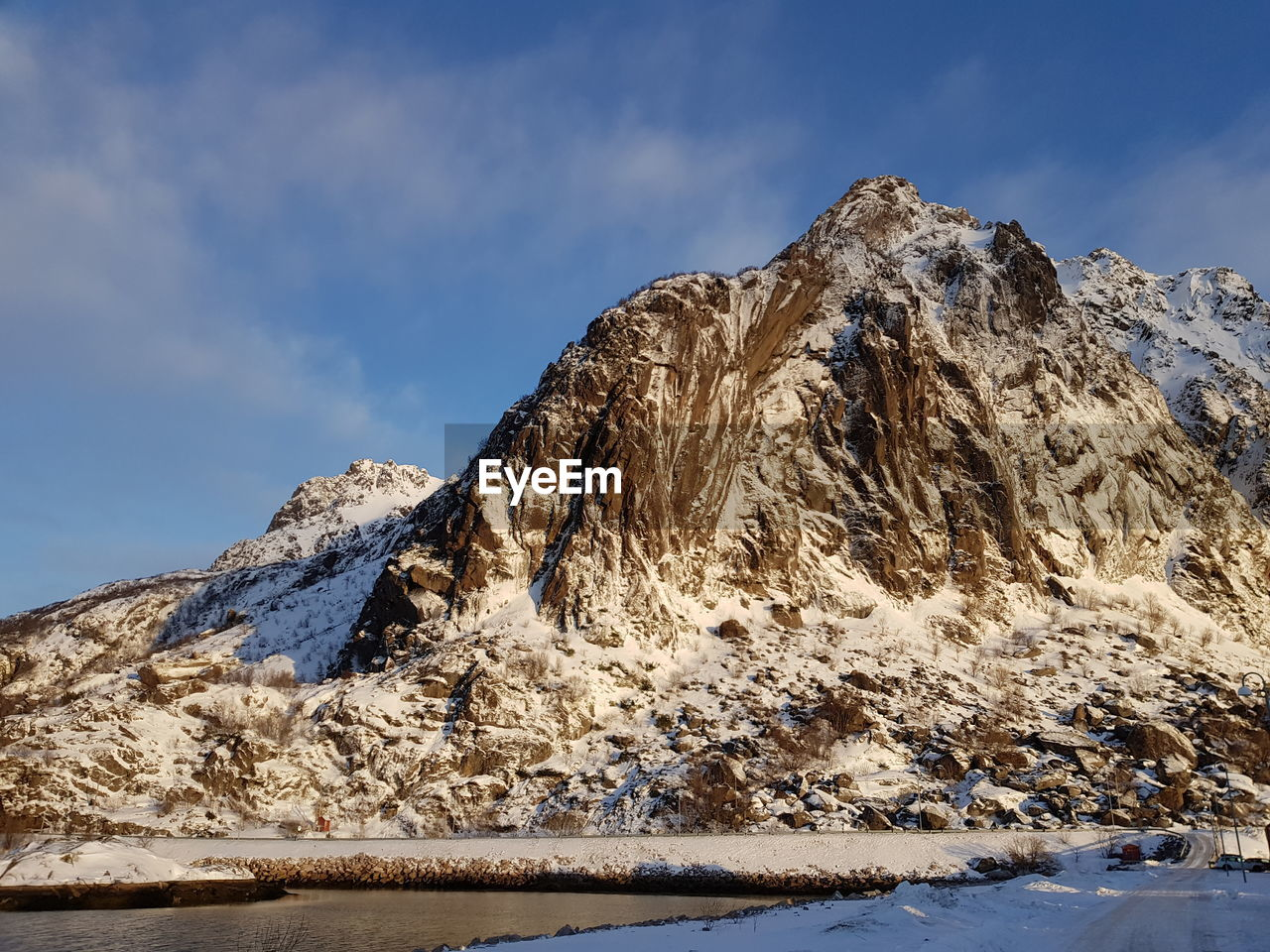 cold temperature, winter, snow, mountain, sky, beauty in nature, scenics - nature, tranquil scene, snowcapped mountain, mountain range, tranquility, cloud - sky, nature, no people, non-urban scene, rock, day, environment, landscape, formation, outdoors, ice, mountain peak, extreme weather
