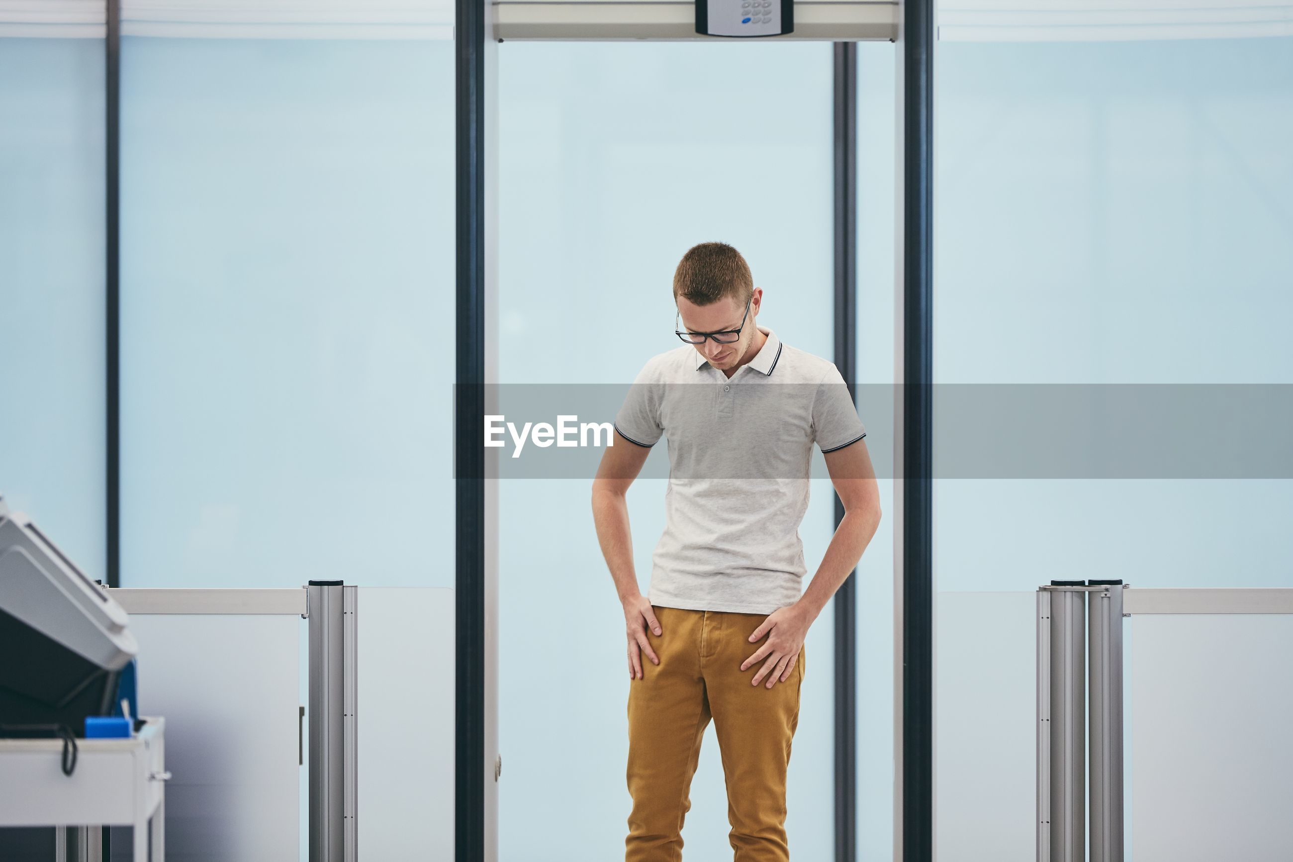 Man touching pockets while standing in airport