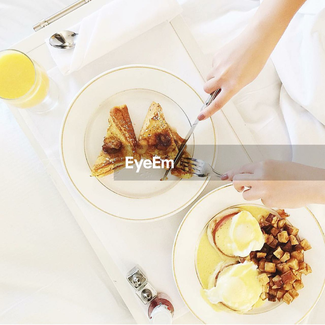Cropped Image Of Woman Having Breakfast On Table At Home