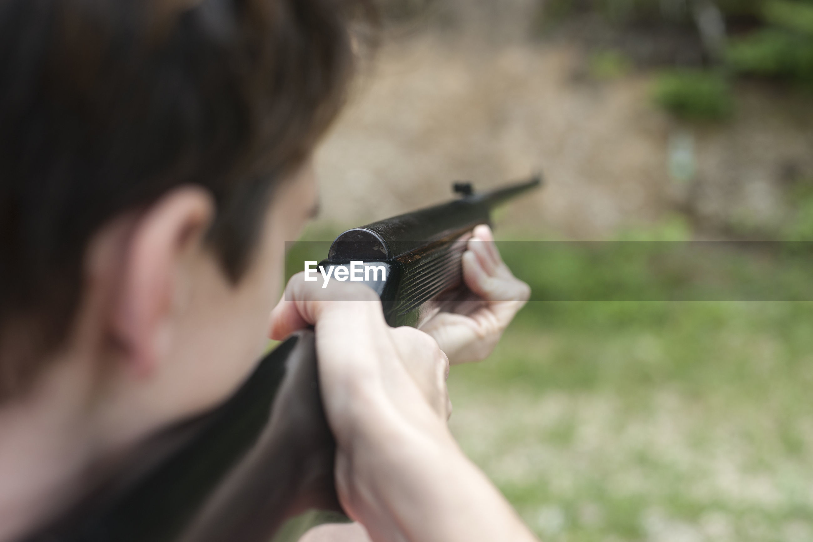 Close-up of man holding gun