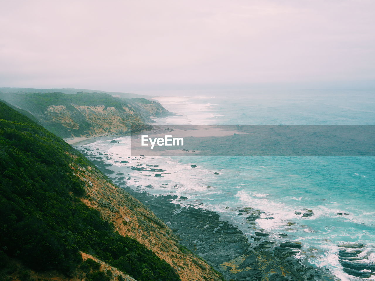 Scenic View Of Sea And Cliff Against Sky