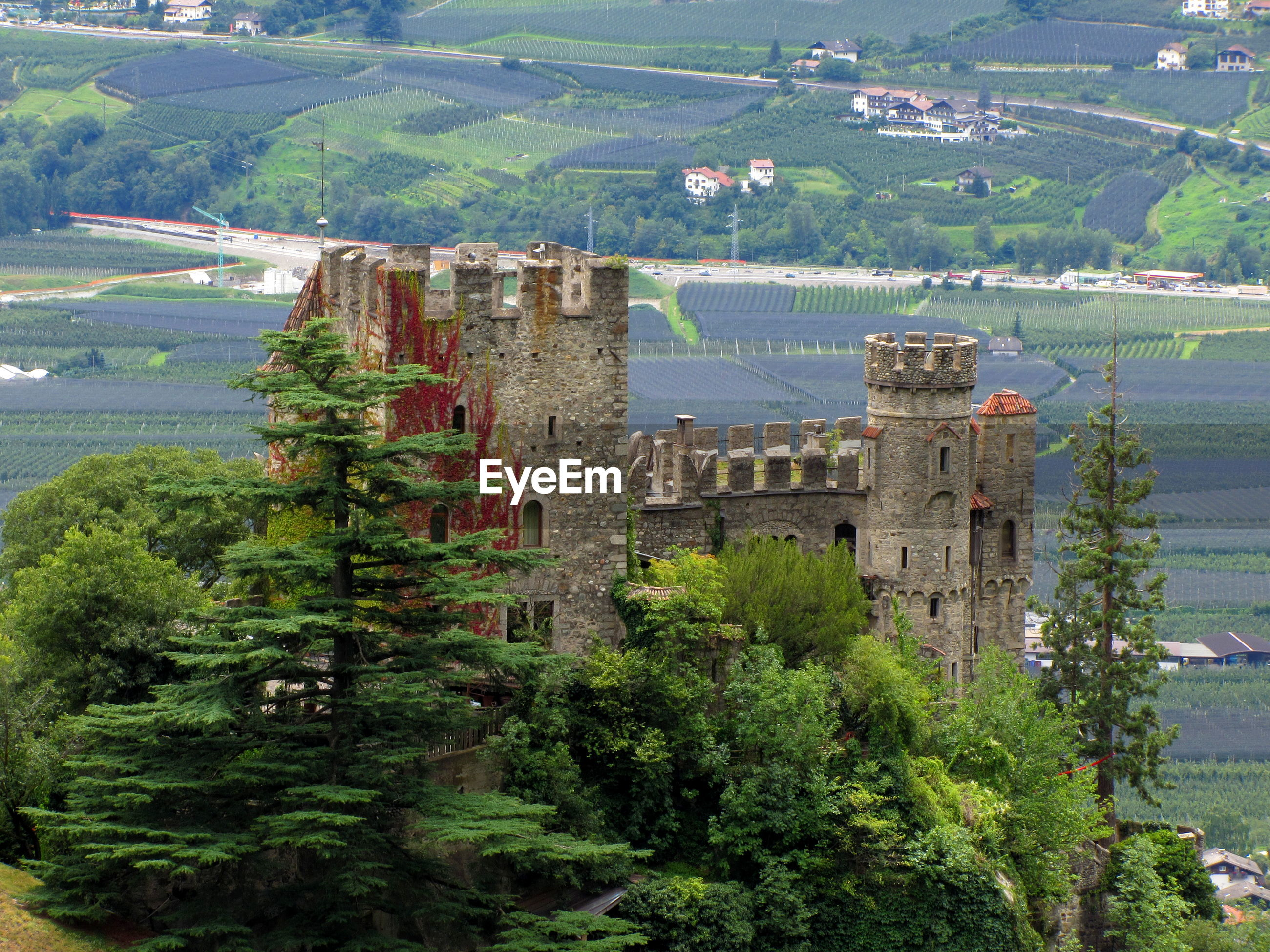 High angle view of castle against agricultural field