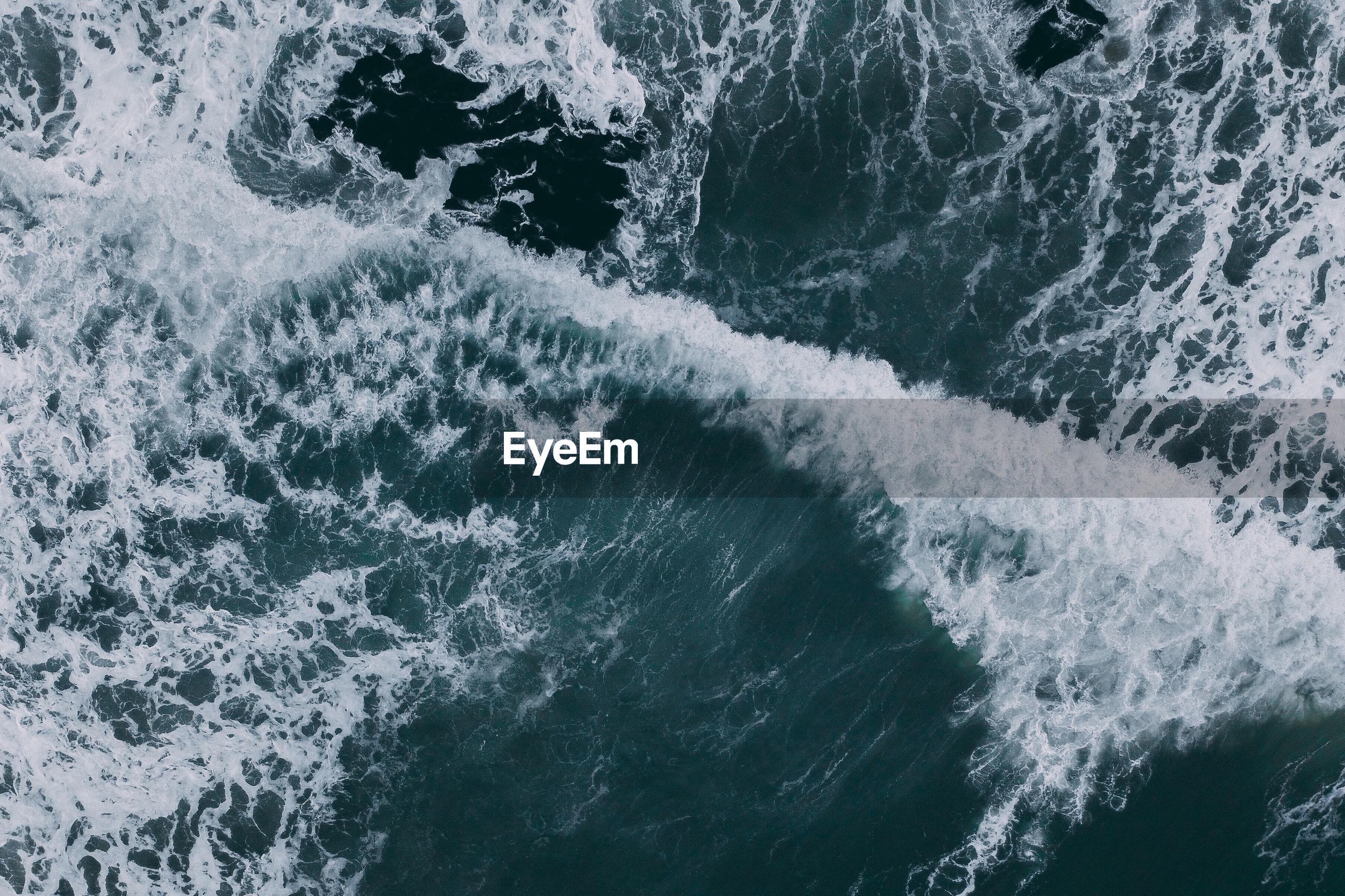 High angle view of water splashing in sea