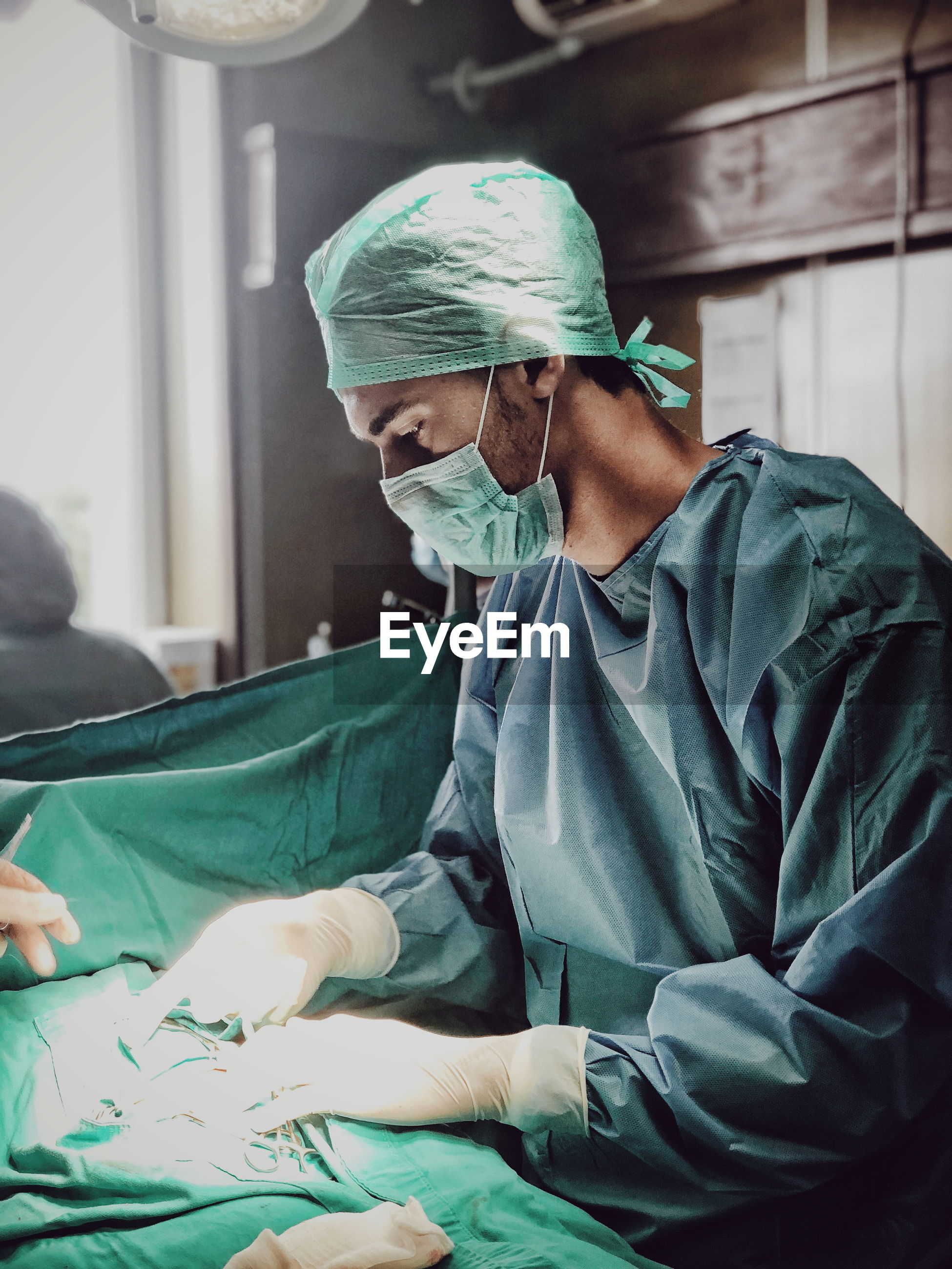Surgeon picking tools at operating room