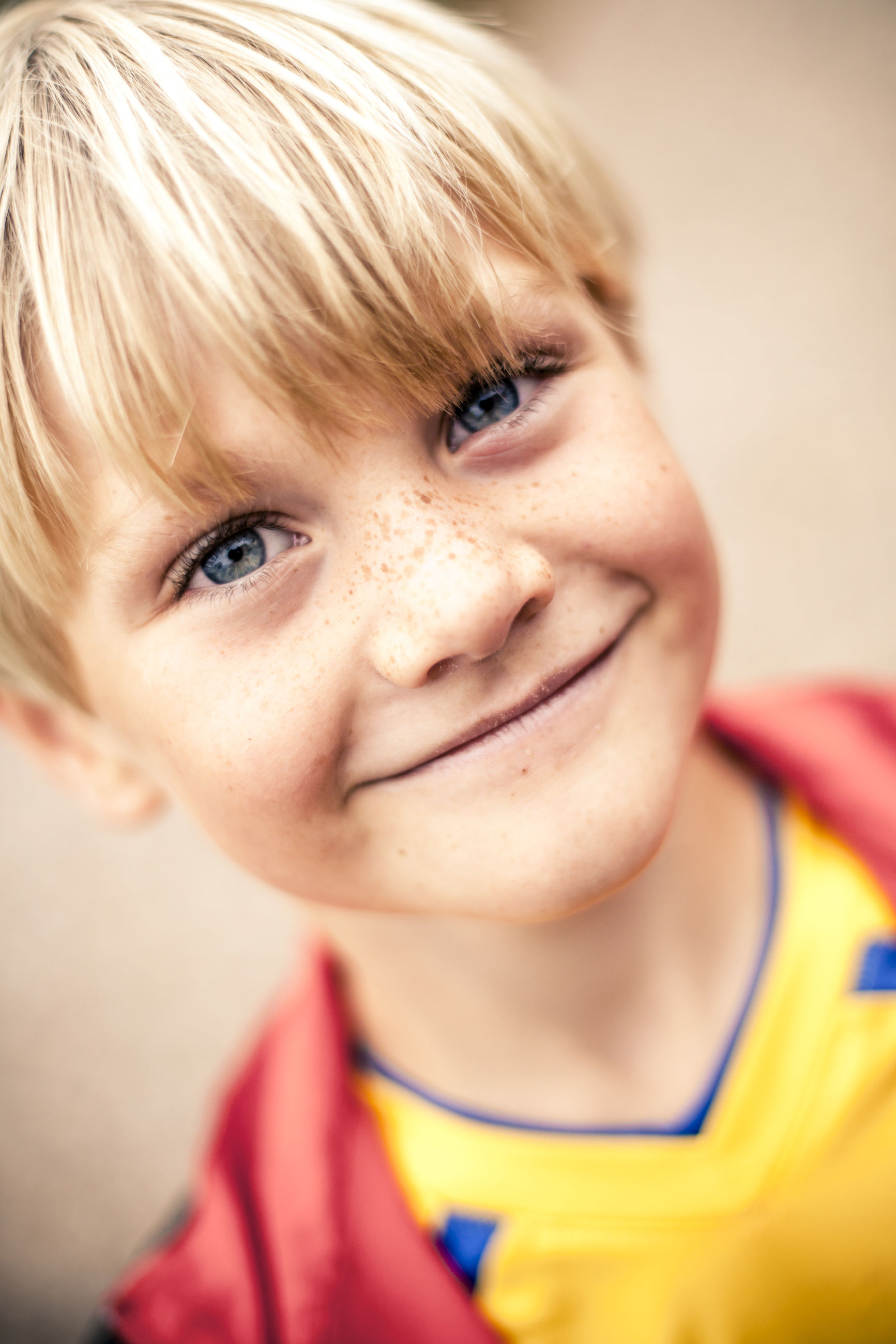 CLOSE-UP PORTRAIT OF SMILING BOY WITH FACE