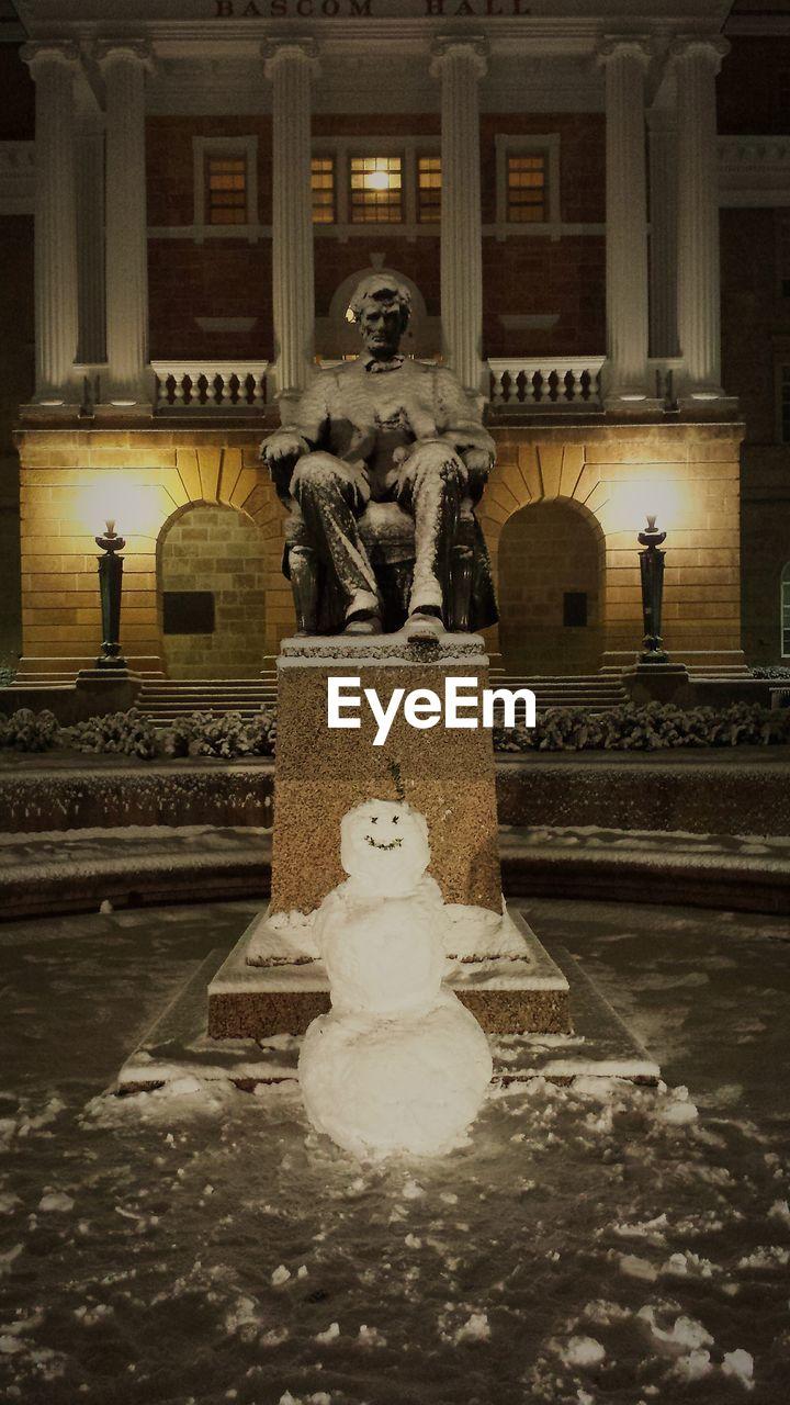 statue, human representation, sculpture, male likeness, art and craft, fountain, creativity, illuminated, night, water, outdoors, no people, architecture