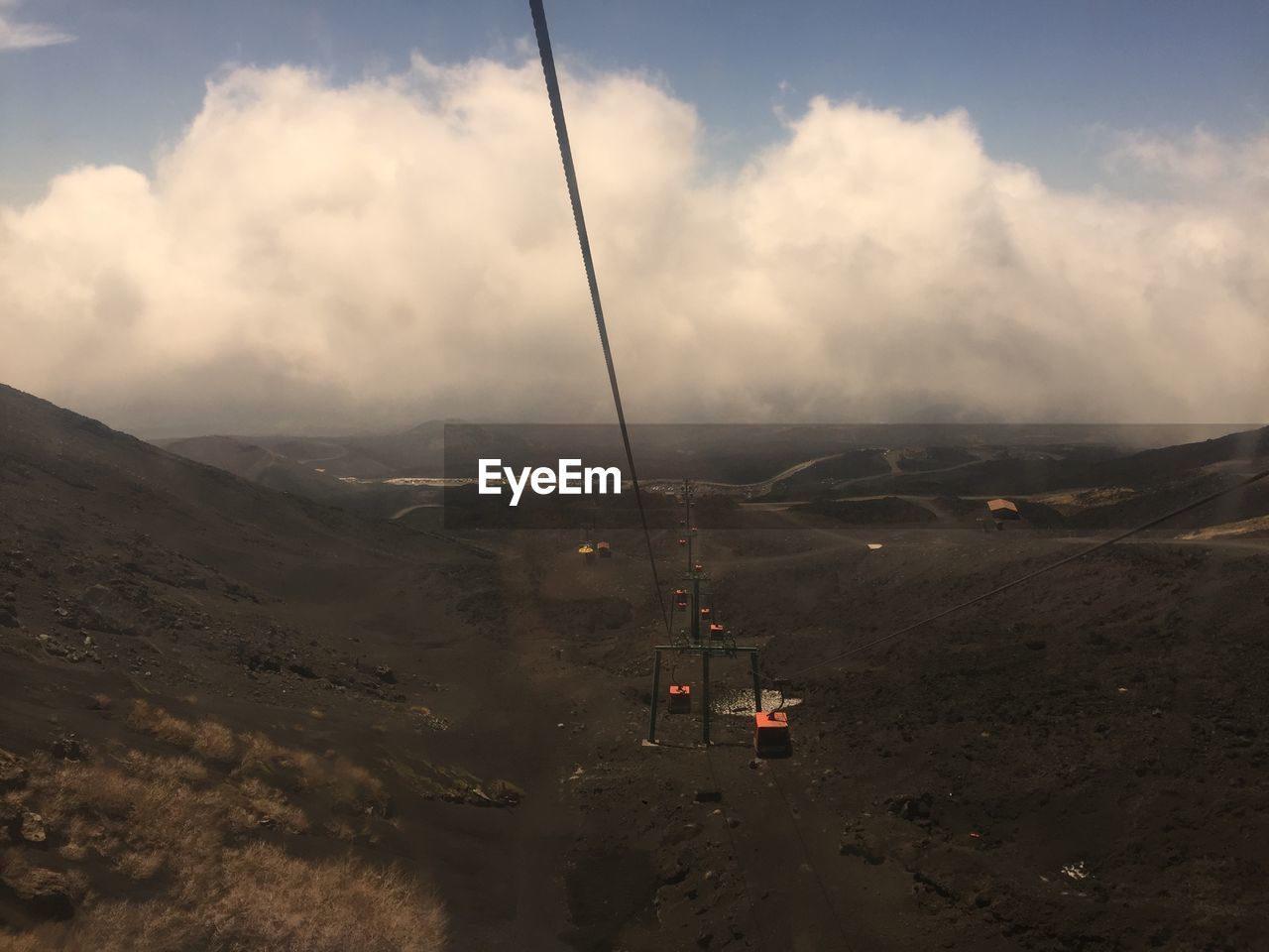 cloud - sky, cable car, sky, environment, transportation, beauty in nature, landscape, mountain, overhead cable car, nature, scenics - nature, no people, mode of transportation, tranquil scene, non-urban scene, ski lift, tranquility, day, cable, outdoors