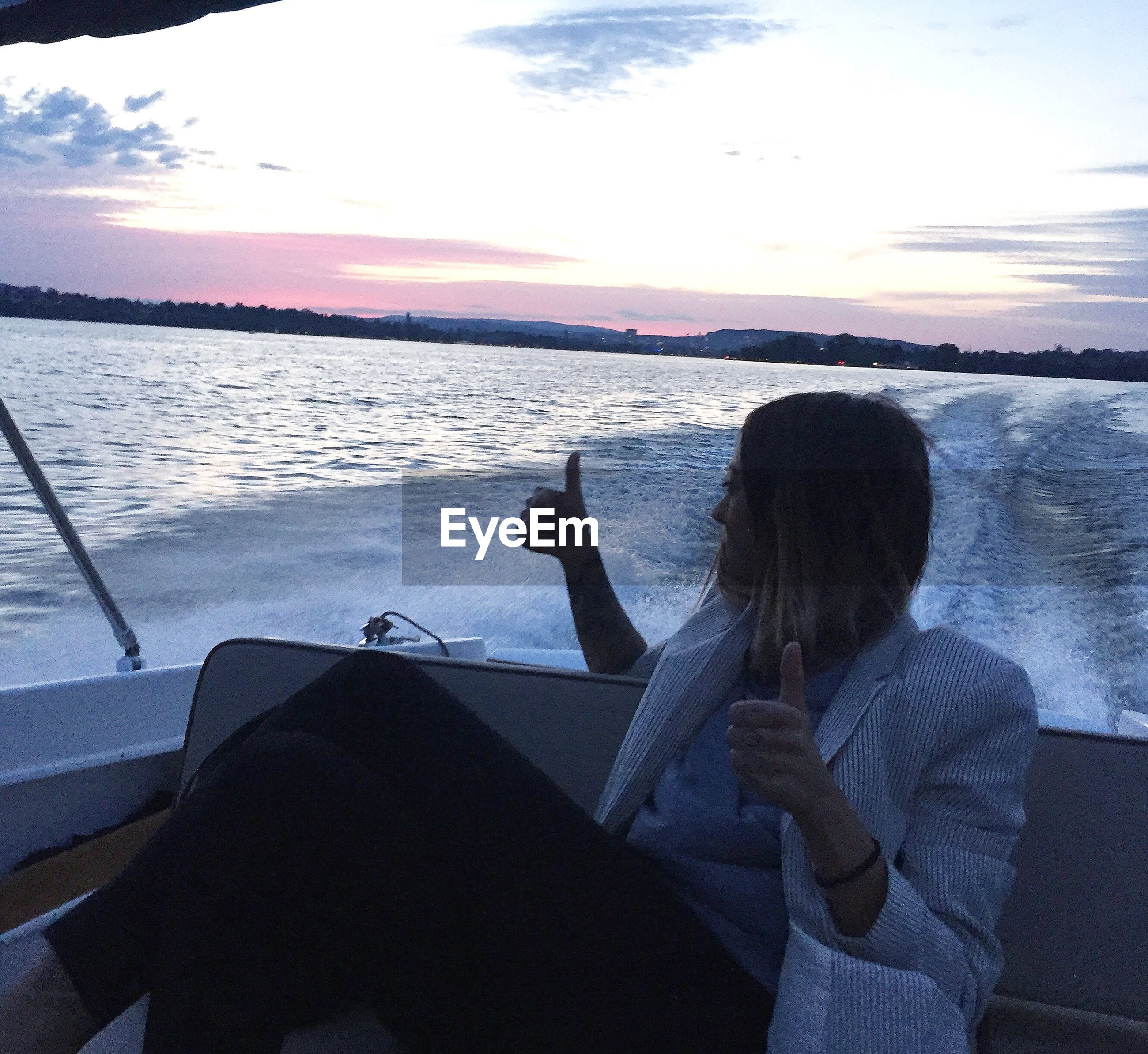 one person, real people, sky, water, sea, rear view, nature, leisure activity, sitting, transportation, sunset, mode of transport, lifestyles, scenics, beauty in nature, women, cloud - sky, nautical vessel, standing, young women, day, young adult, horizon over water, outdoors, people