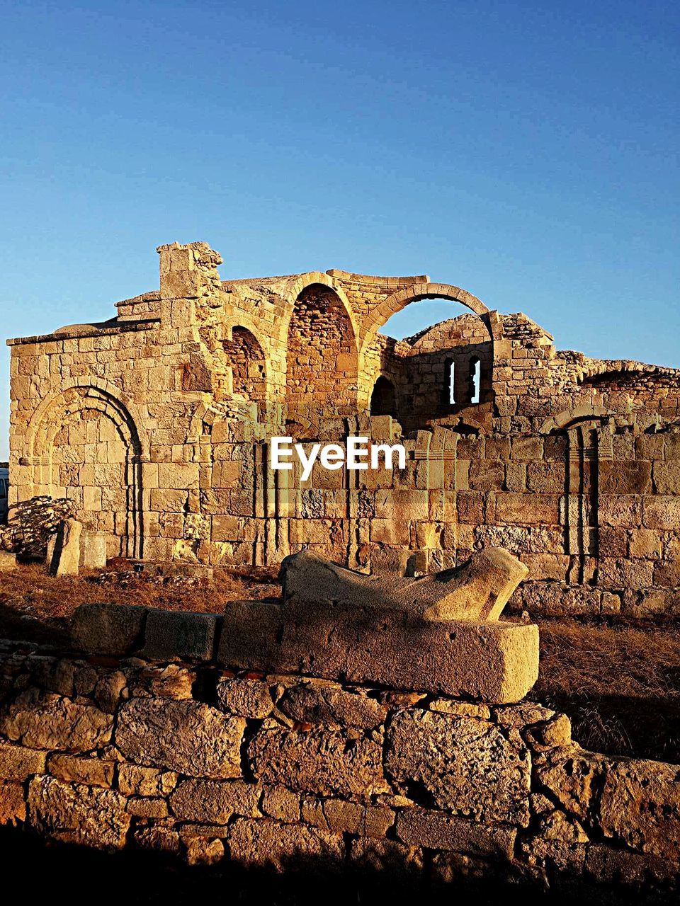history, the past, ancient, architecture, built structure, clear sky, sky, old ruin, wall, old, building exterior, damaged, arch, blue, travel destinations, day, ruined, ancient civilization, nature, tourism, no people, deterioration, stone wall, archaeology, outdoors, arched