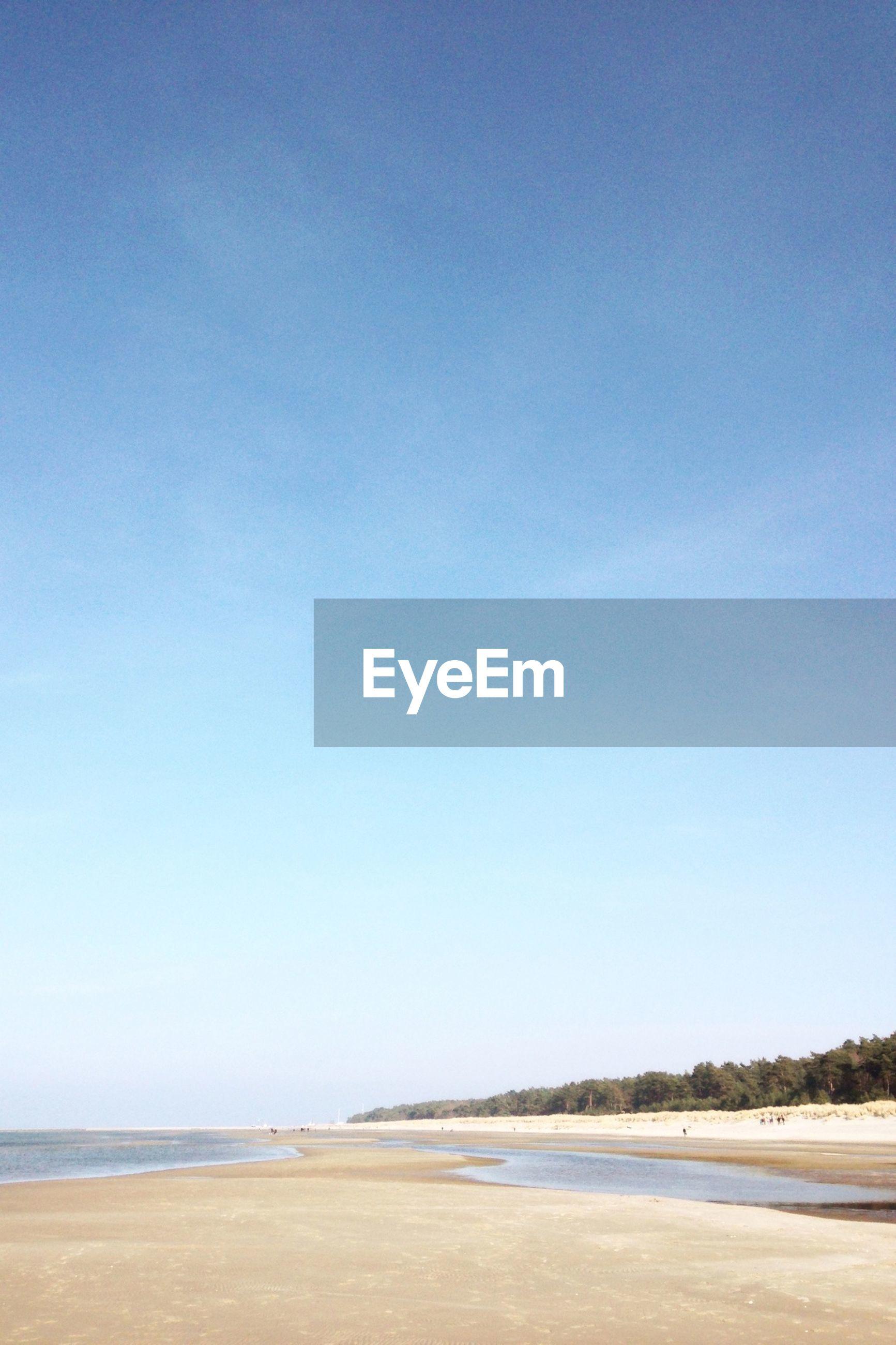 beach, sea, water, sand, tranquil scene, tranquility, shore, clear sky, scenics, blue, copy space, horizon over water, beauty in nature, nature, coastline, idyllic, sky, non-urban scene, calm, day