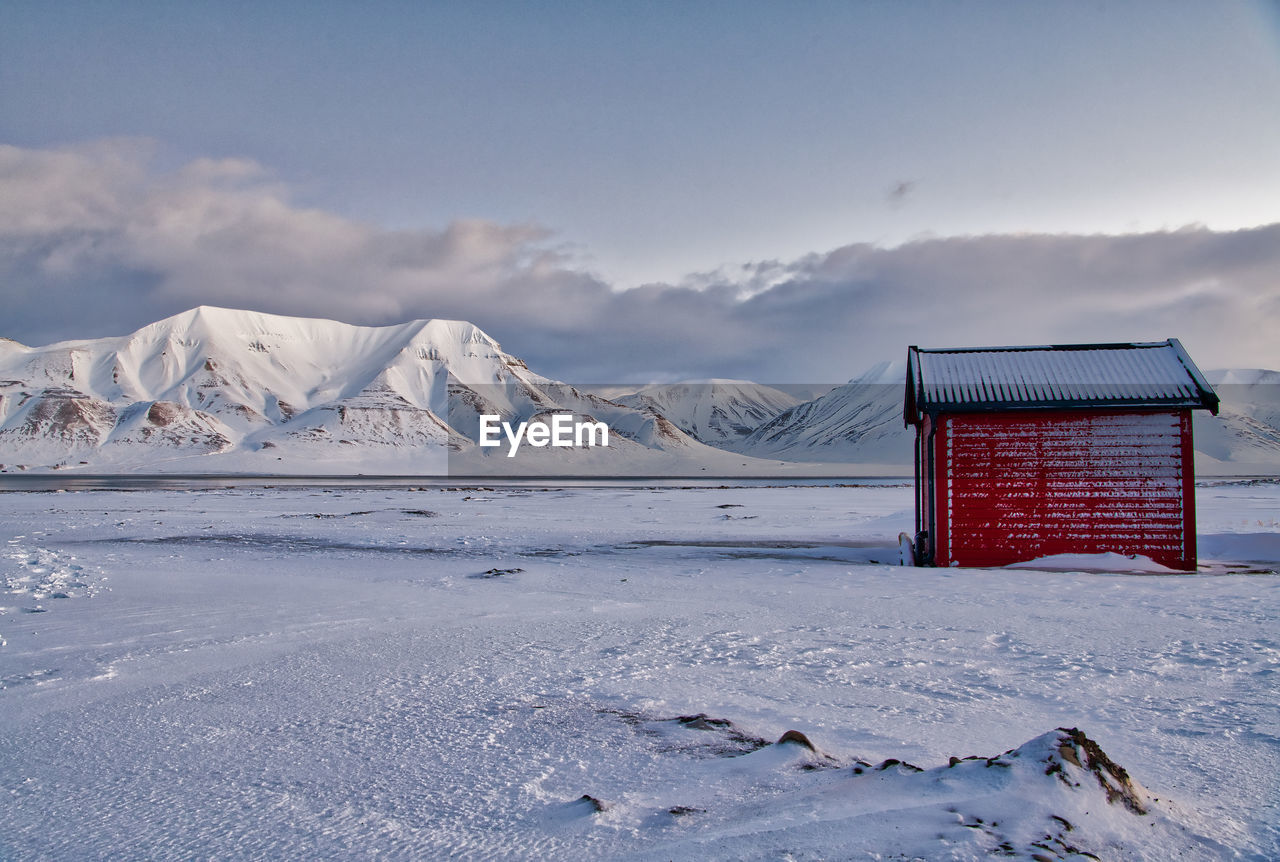House on snow covered field