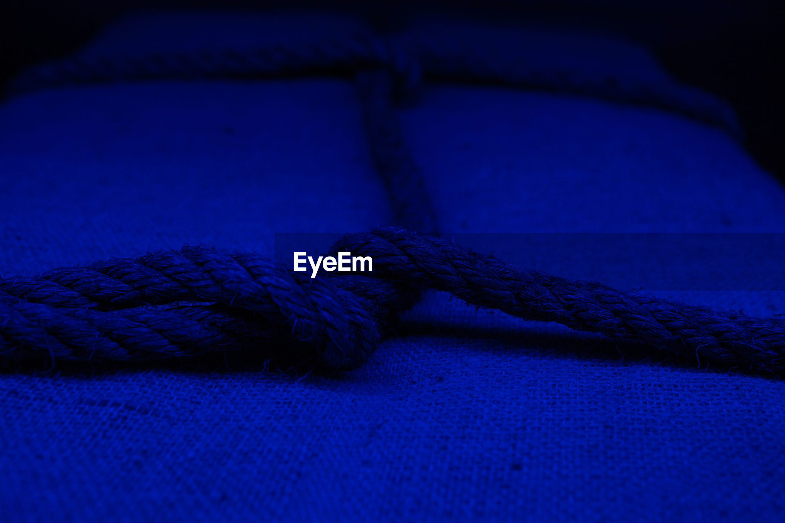 High angle view of rope tied up on fabric