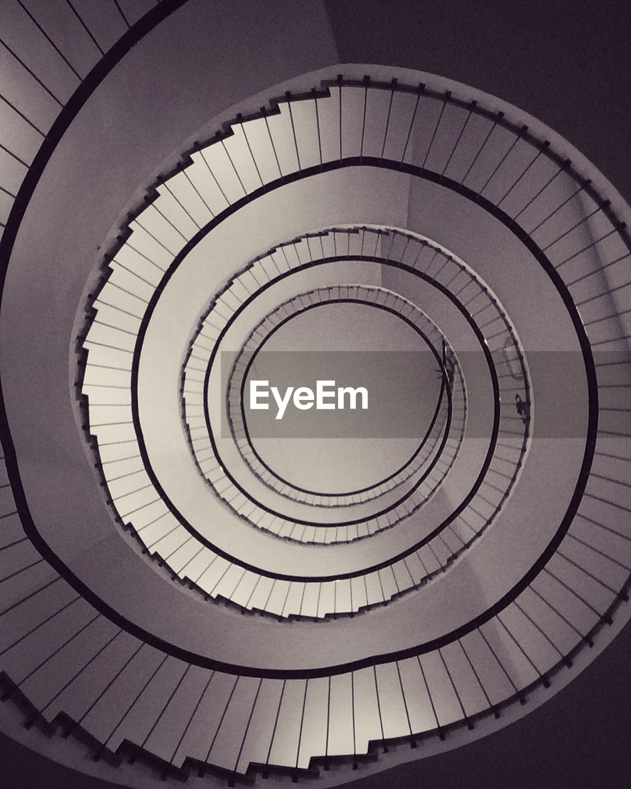 HIGH ANGLE VIEW OF SPIRAL STAIRS