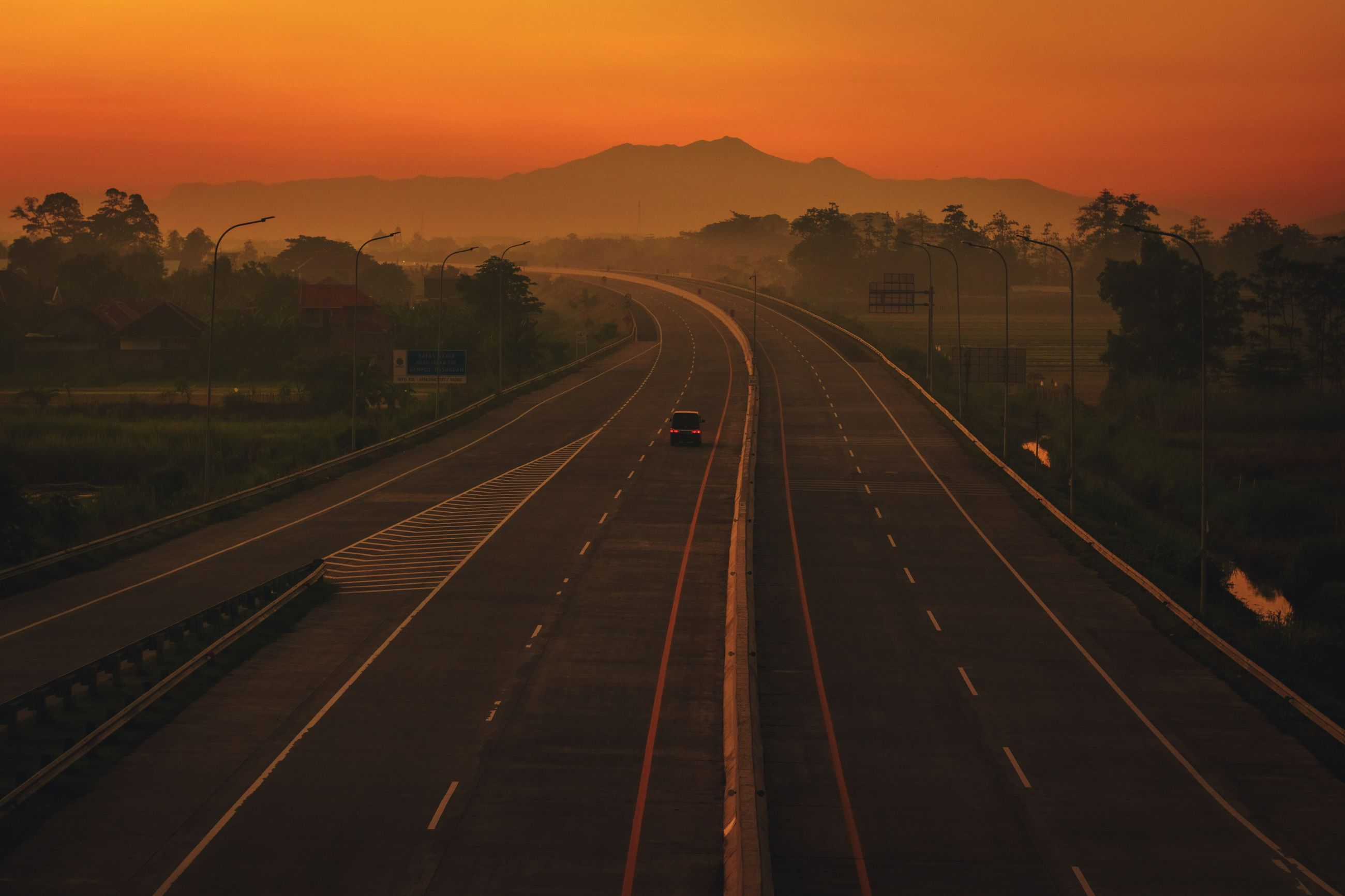 High angle view of highway against sky during sunrise.