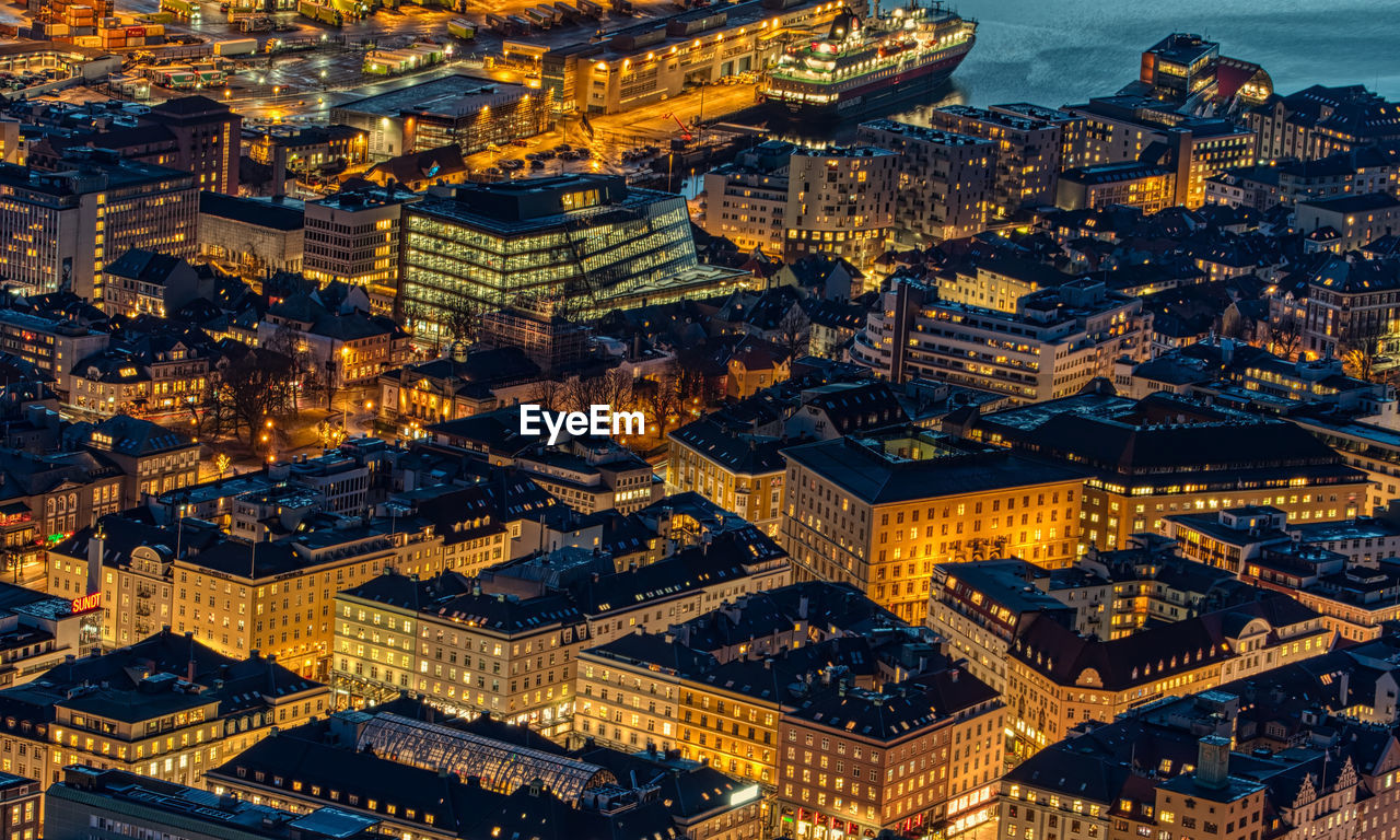 building exterior, architecture, city, cityscape, built structure, building, night, high angle view, illuminated, crowded, residential district, aerial view, travel destinations, outdoors, nature, dusk, city life