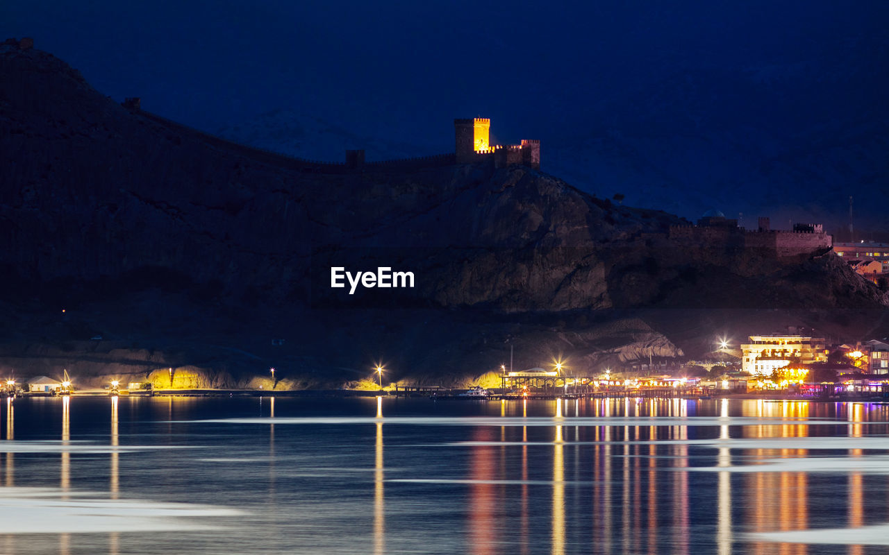 Night view of genoese fortress from water in crimea