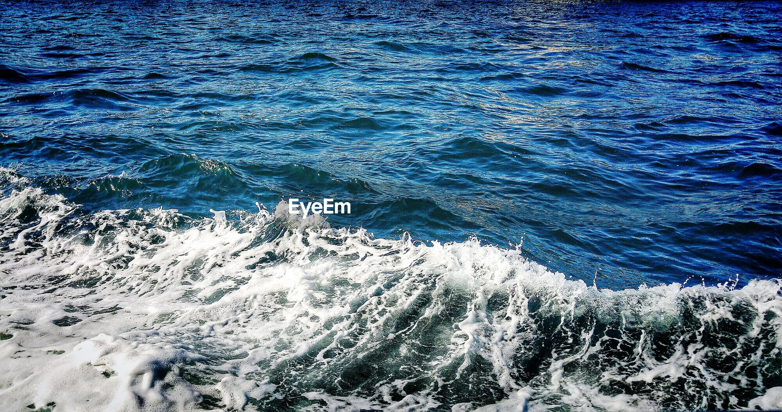 water, sea, surf, blue, rippled, scenics, nature, wave, beauty in nature, seascape, day, tranquil scene, outdoors, cliff, non-urban scene, tranquility, splashing, breaking, tourism, wake, tide, water surface, remote, vacations, majestic, waterfront, no people, power in nature