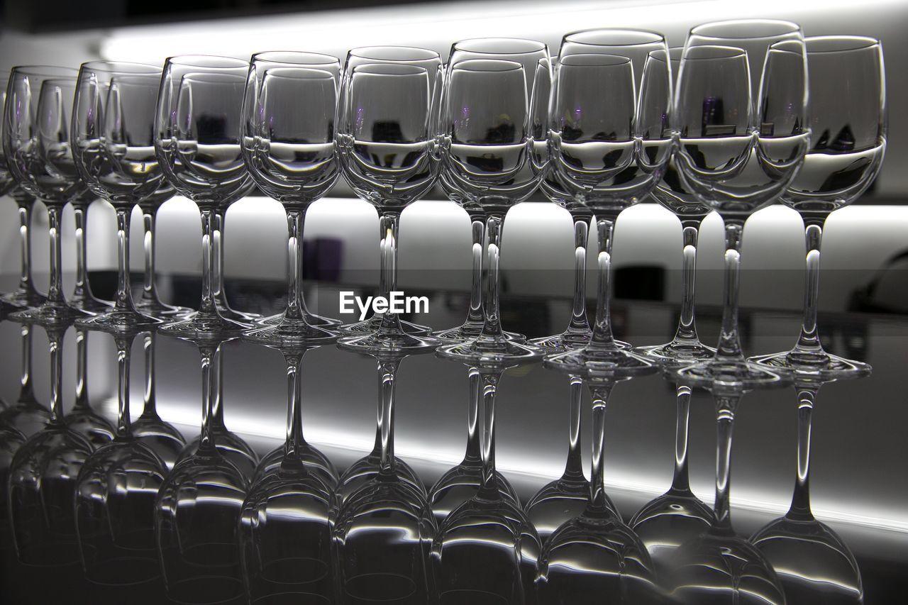 ROW OF WINE IN GLASS BOTTLES