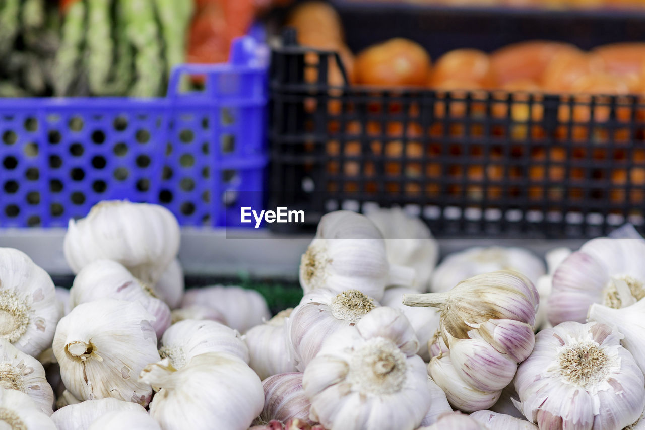 Close-Up Of Garlics For Sale In Market