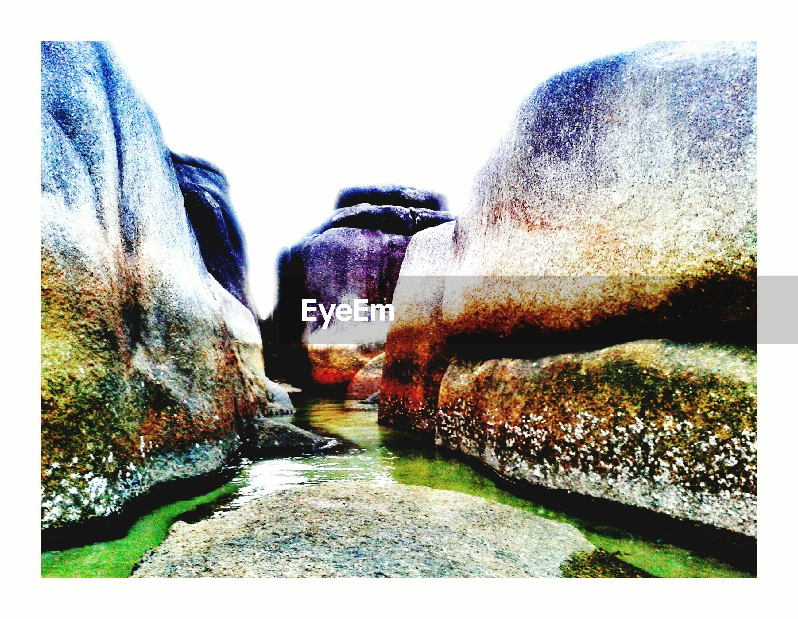 transfer print, clear sky, auto post production filter, rock - object, nature, rock formation, day, tranquility, copy space, outdoors, tranquil scene, tree, beauty in nature, sunlight, blue, no people, plant, scenics, grass, travel destinations