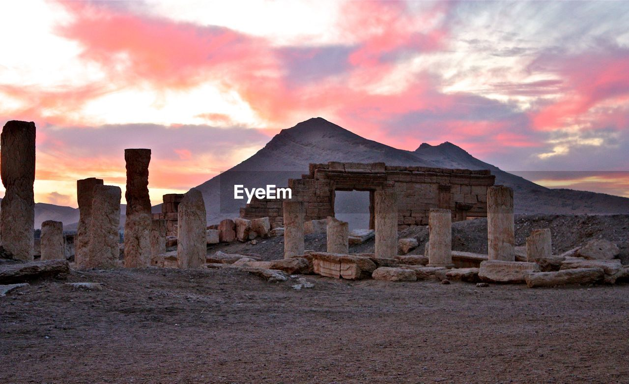 sky, sunset, history, the past, cloud - sky, architecture, built structure, ancient, ancient civilization, old ruin, no people, travel destinations, outdoors, nature, tranquility, building exterior, mountain, landscape, scenics, day, beauty in nature
