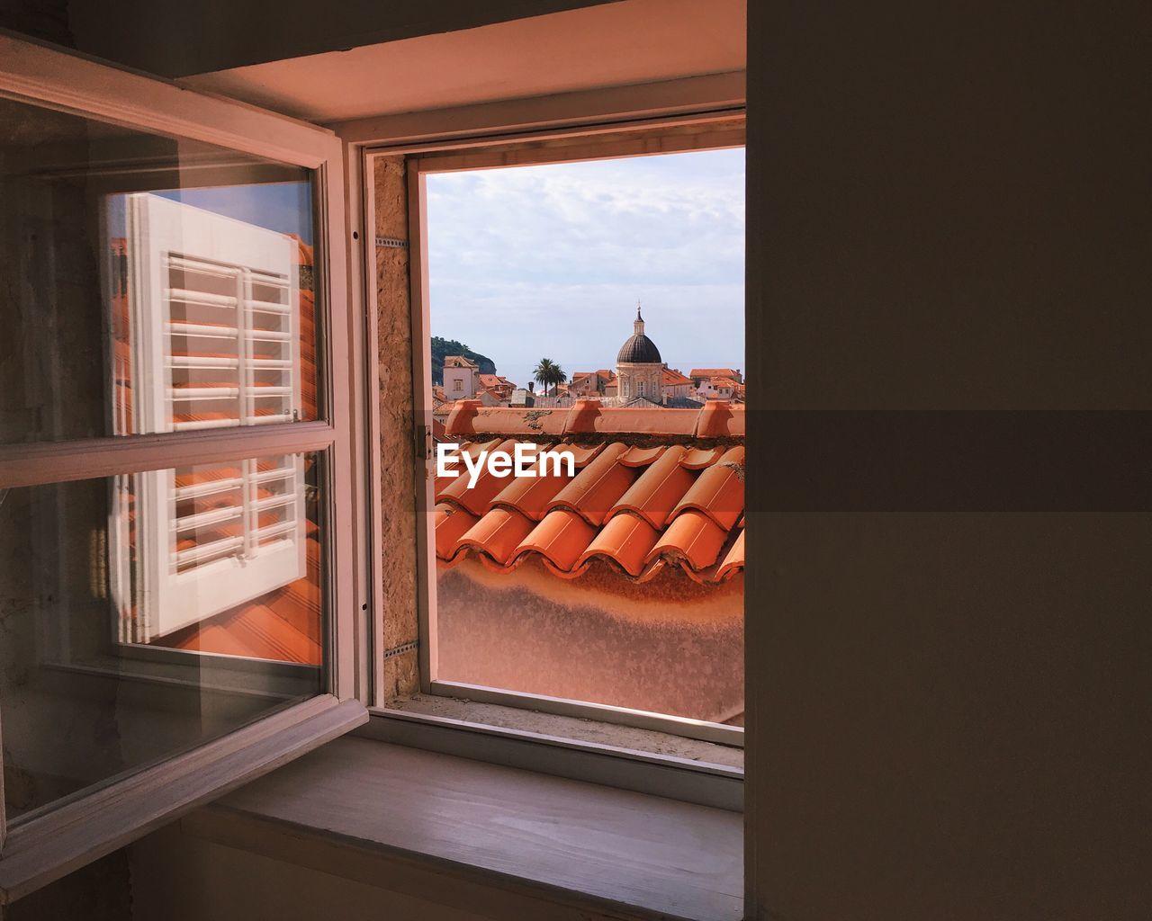 Tiled Roof Seen Through Window