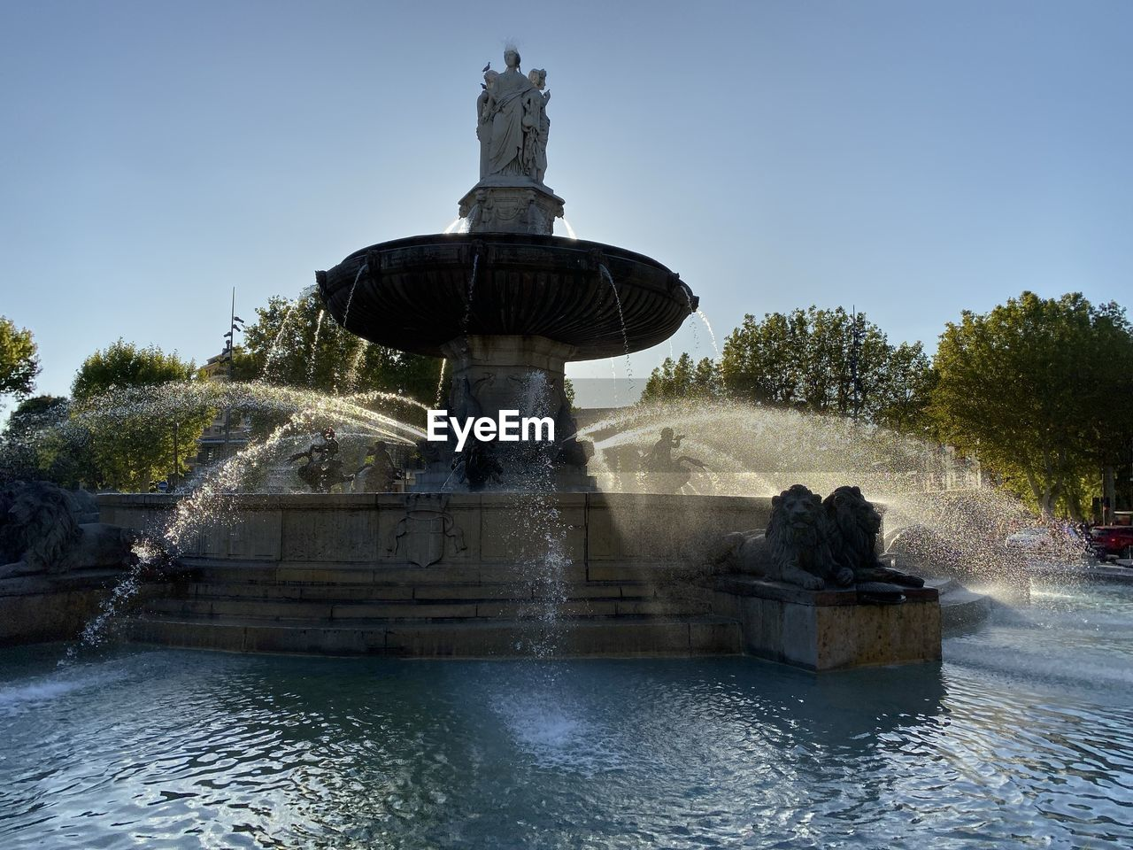 water, fountain, nature, sky, architecture, sculpture, tree, plant, art and craft, statue, representation, splashing, spraying, clear sky, human representation, day, flowing water, motion, waterfront, no people, outdoors, flowing