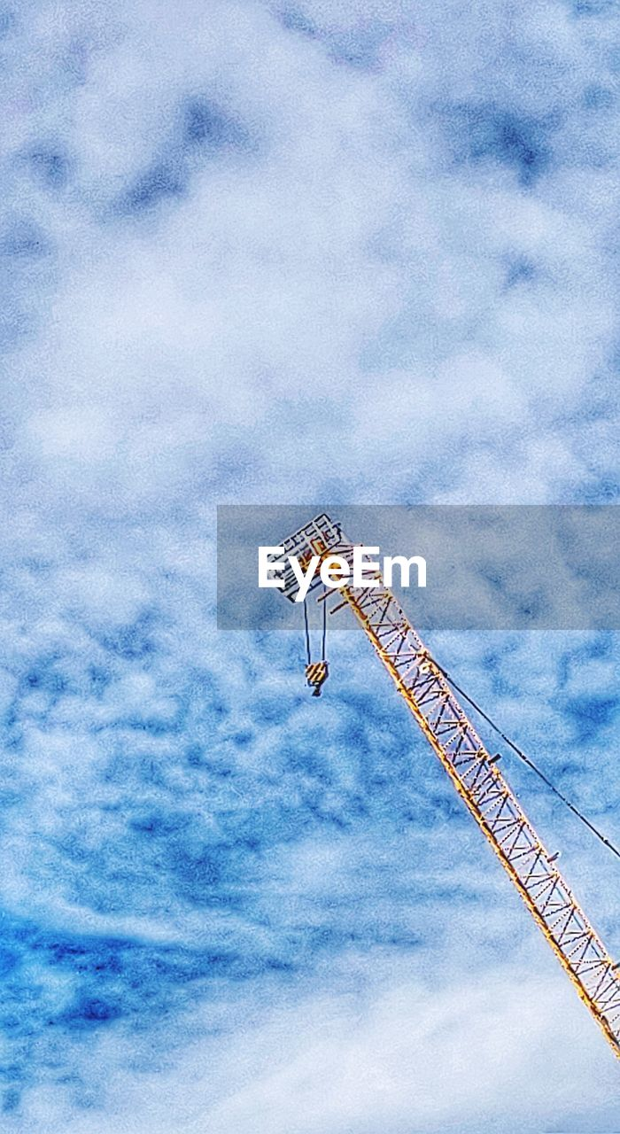 cloud - sky, low angle view, sky, machinery, crane - construction machinery, construction machinery, nature, tall - high, construction industry, day, architecture, construction site, no people, industry, outdoors, blue, metal, built structure, amusement park, development, construction equipment