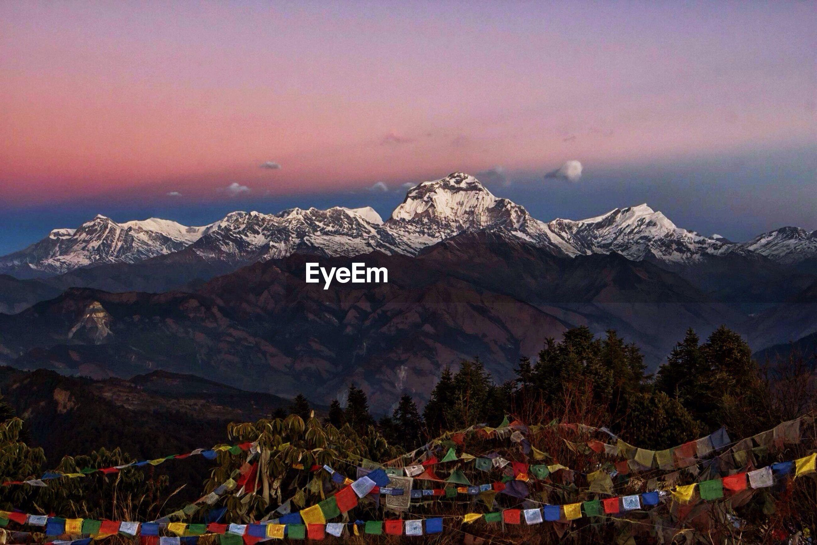 Prayer flags at annapurna mountain during sunset