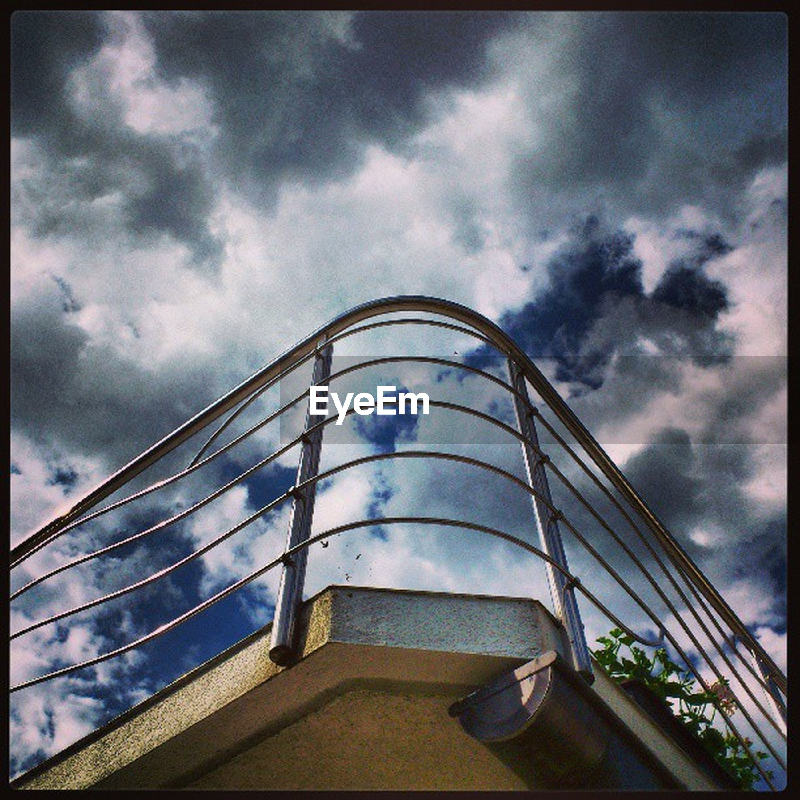 sky, cloud - sky, architecture, built structure, cloudy, transfer print, auto post production filter, railing, low angle view, cloud, building exterior, day, outdoors, no people, modern, metal, steps, blue, overcast, building