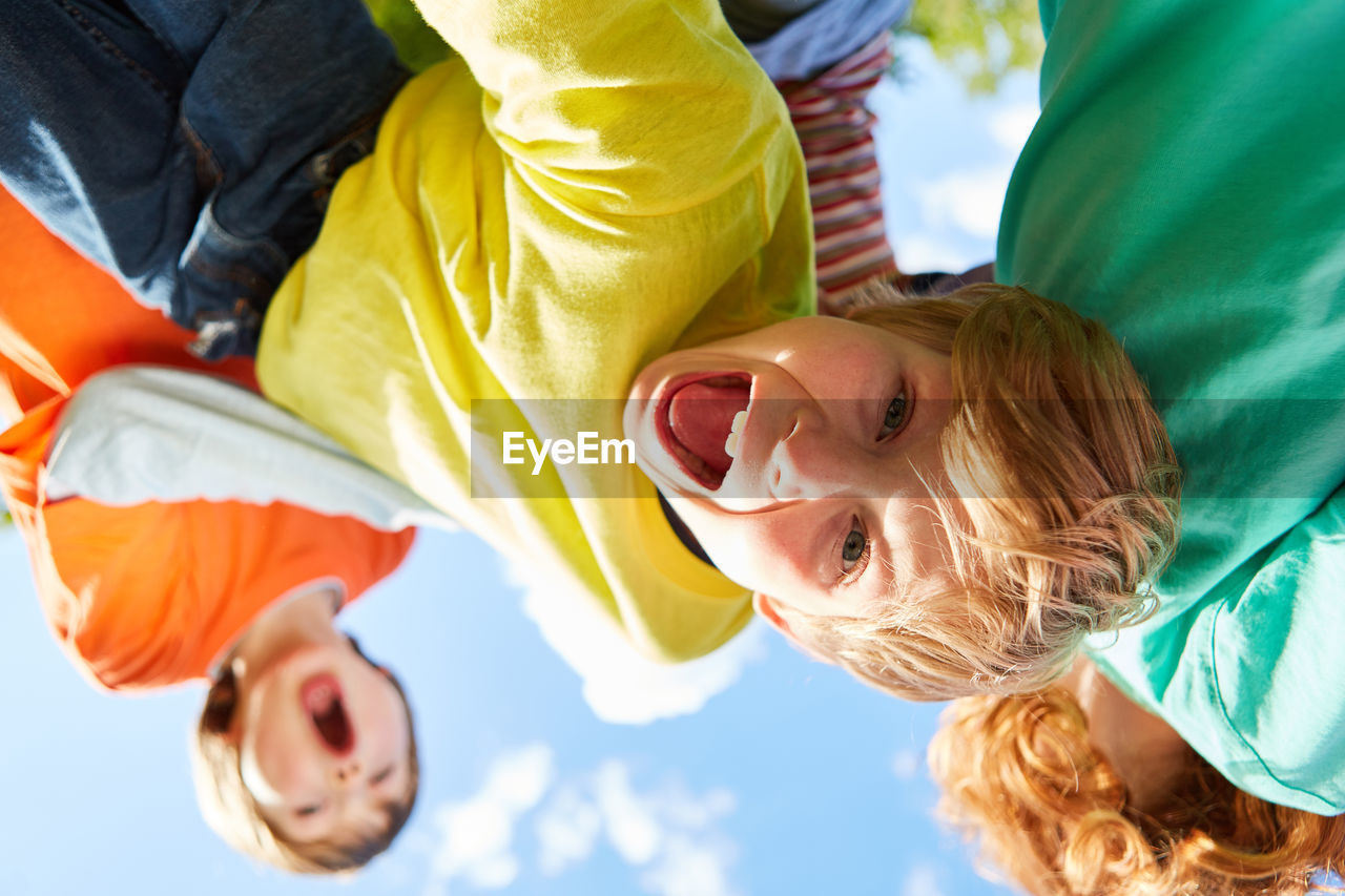 HIGH ANGLE VIEW PORTRAIT OF SIBLINGS PLAYING