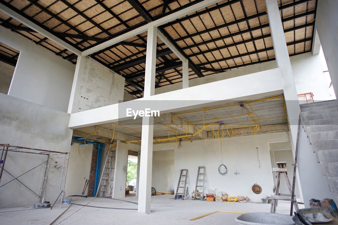 architecture, built structure, no people, indoors, building, industry, day, domestic room, wall - building feature, white color, abandoned, architectural column, empty, ceiling, entrance, construction site, sunlight, flooring, home improvement