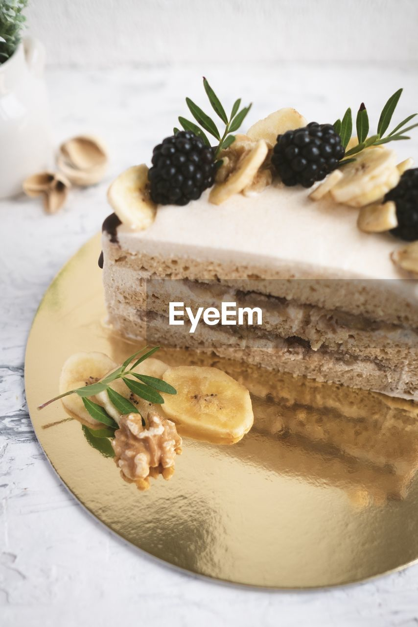 food, food and drink, indulgence, still life, freshness, plate, ready-to-eat, temptation, dessert, sweet food, sweet, indoors, close-up, serving size, cake, baked, no people, table, unhealthy eating, garnish, herb, mint leaf - culinary, food styling