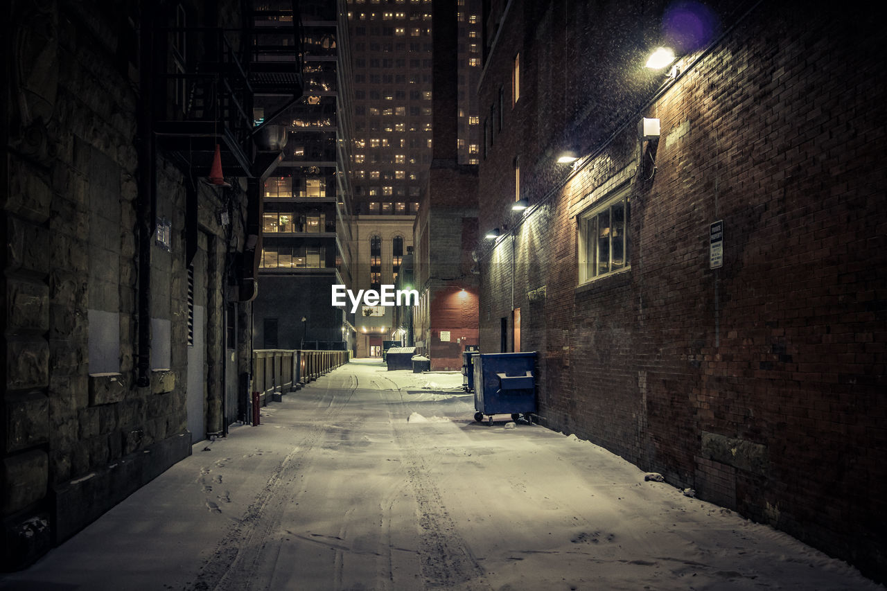 architecture, building exterior, built structure, illuminated, night, city, building, street, residential district, direction, the way forward, street light, no people, lighting equipment, outdoors, empty, transportation, alley, nature, snow, electric lamp