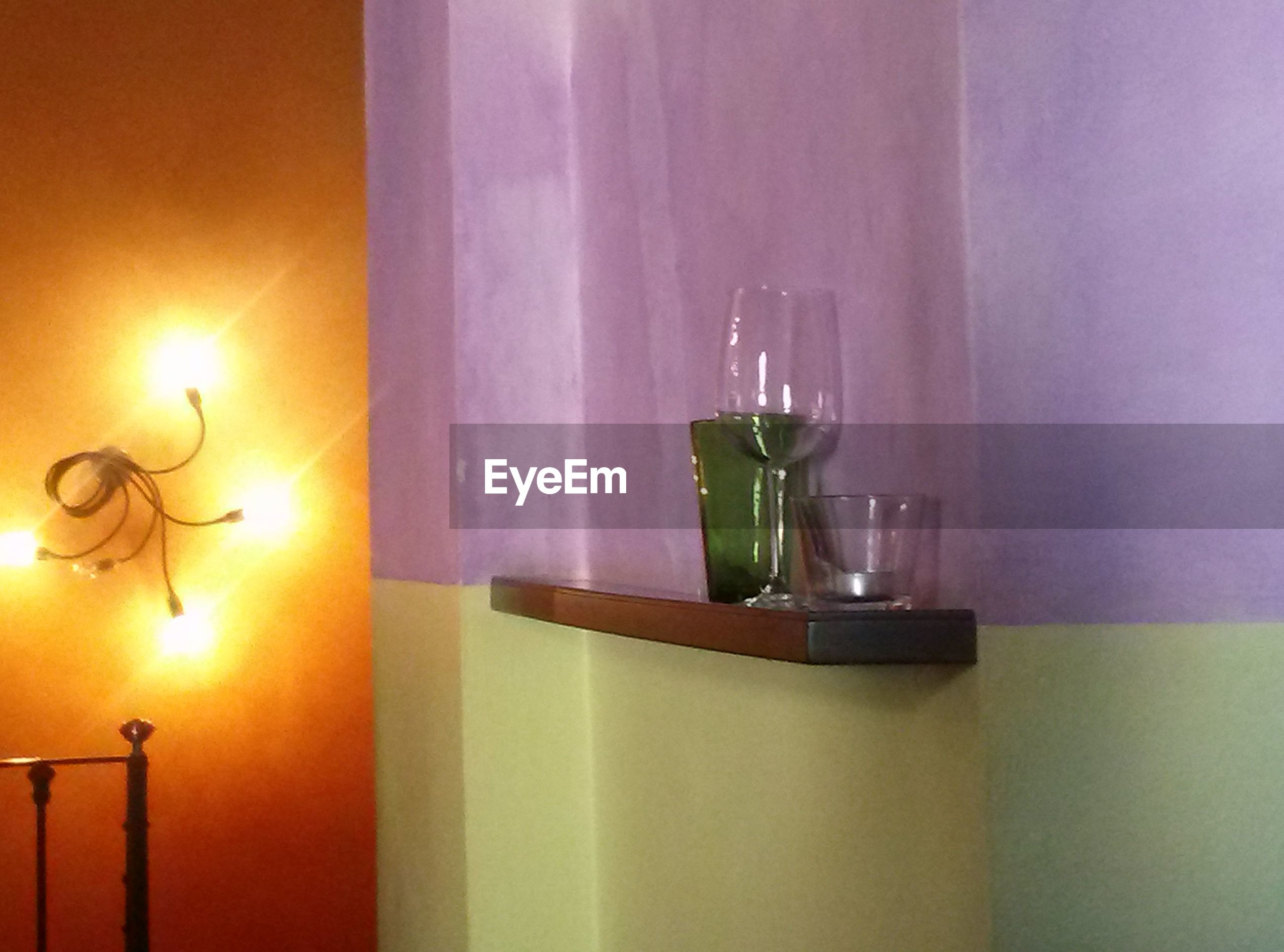 indoors, illuminated, lighting equipment, home interior, candle, glowing, hanging, decoration, electric lamp, table, wall - building feature, lamp, decor, no people, electricity, light - natural phenomenon, lit, burning, flame, glass - material