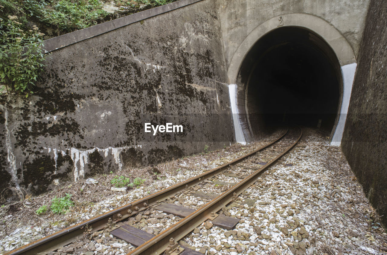 architecture, track, rail transportation, railroad track, built structure, transportation, day, no people, tunnel, arch, nature, outdoors, public transportation, the way forward, direction, motion, connection, water, bridge - man made structure, flowing water