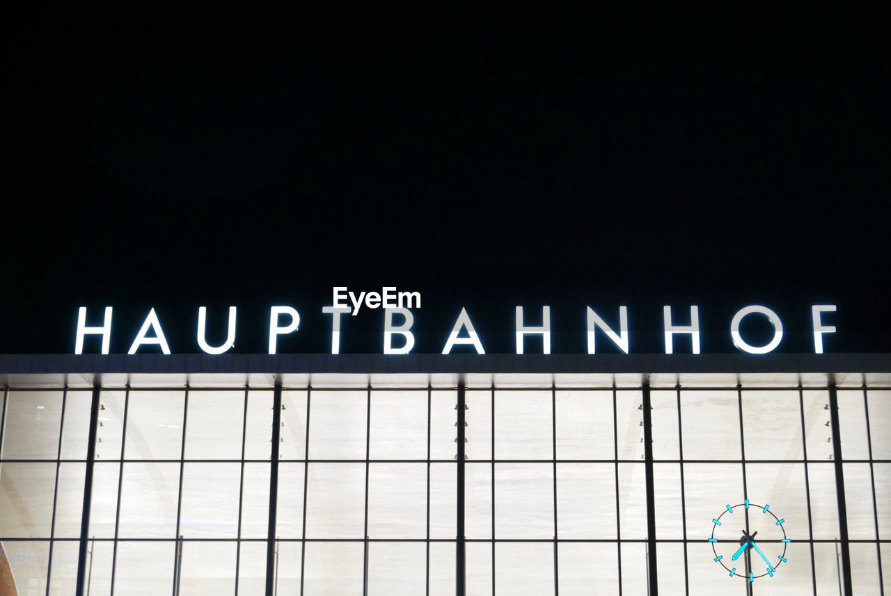 Low Angle View Of Illuminated Text On Berlin Hauptbahnhof Against Sky At Night