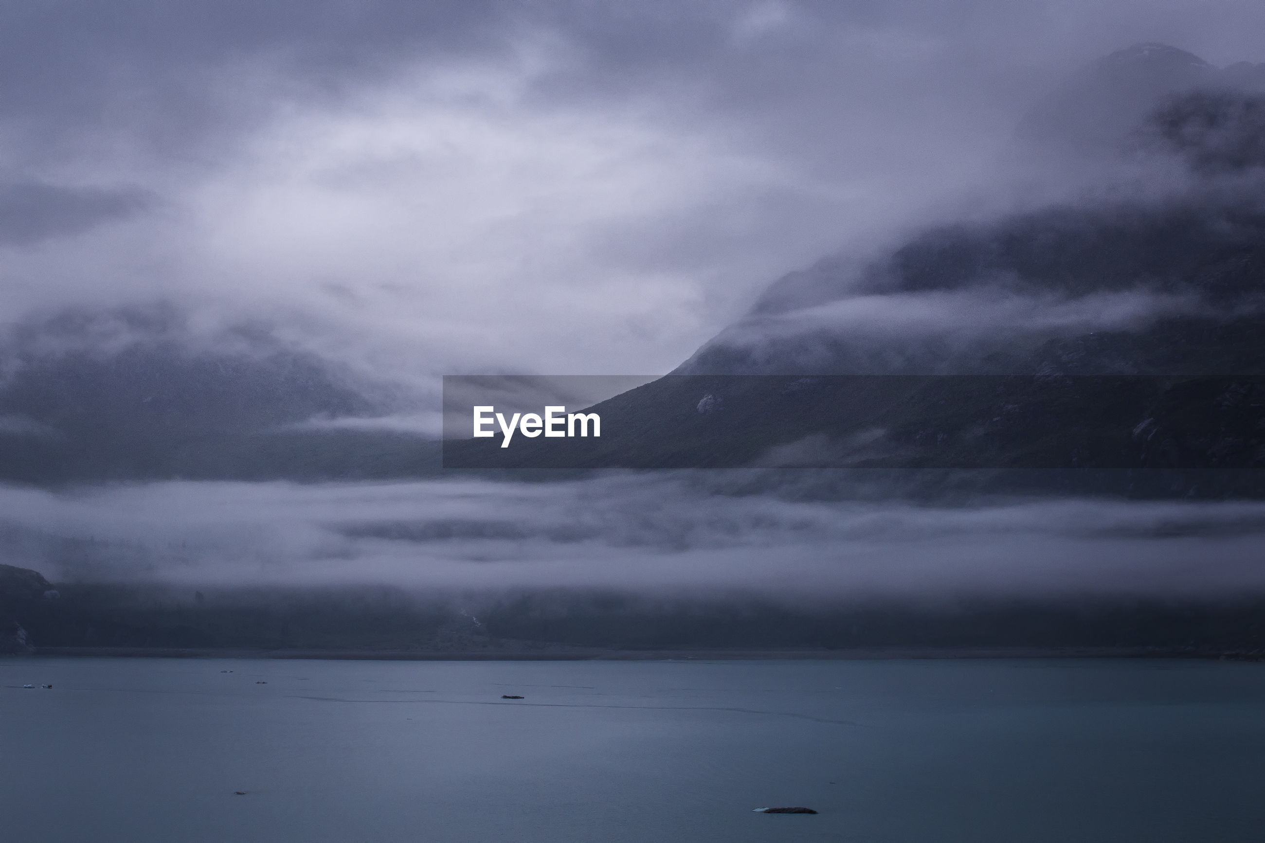 VIEW OF CALM SEA AGAINST CLOUDS