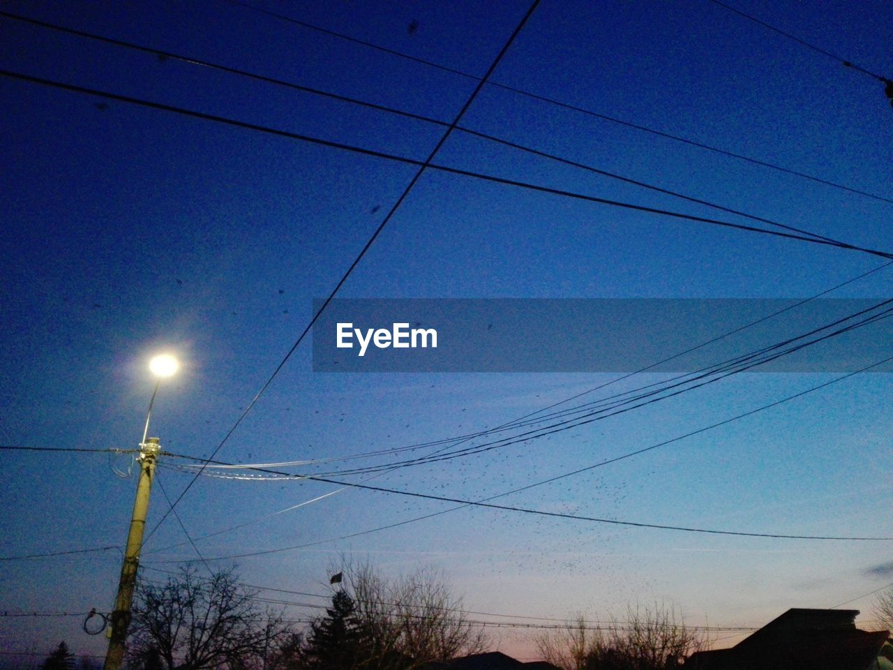 cable, electricity, power line, fuel and power generation, power supply, sky, low angle view, blue, connection, technology, no people, electricity pylon, outdoors, sun, nature, silhouette, moon, clear sky, beauty in nature, tree, day