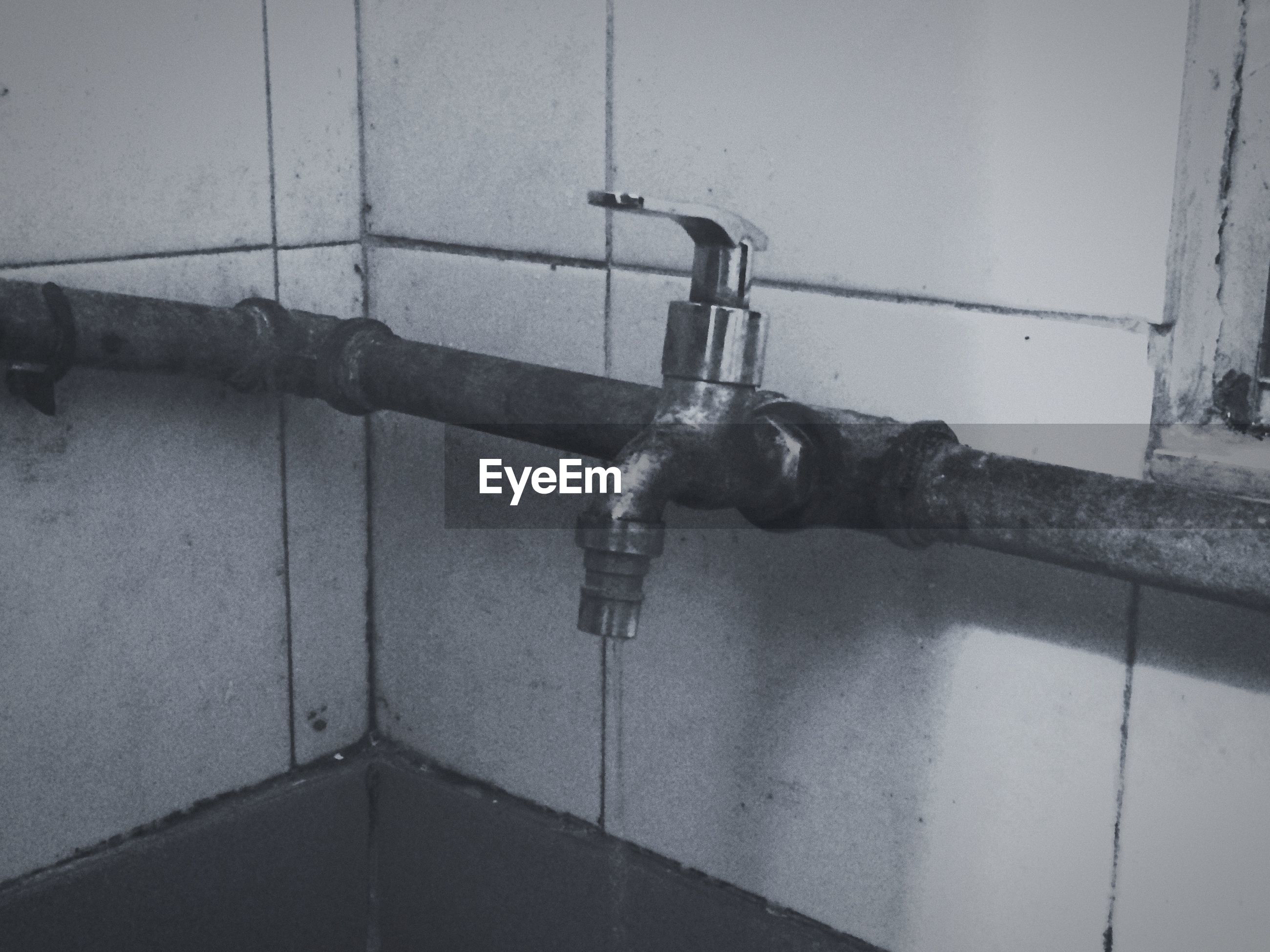 indoors, wall - building feature, metal, built structure, faucet, lighting equipment, close-up, wall, architecture, bathroom, old, electricity, hanging, no people, metallic, pipe - tube, protection, technology, door, handle