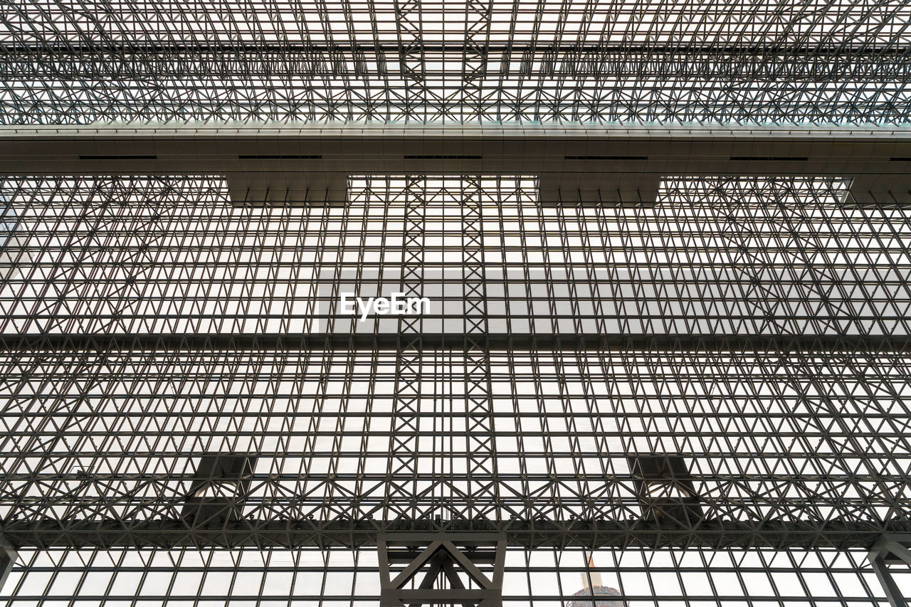 architecture, built structure, pattern, no people, metal, full frame, indoors, day, low angle view, backgrounds, grid, building, design, transportation, railing, glass - material, window, safety, ceiling, iron - metal, steel