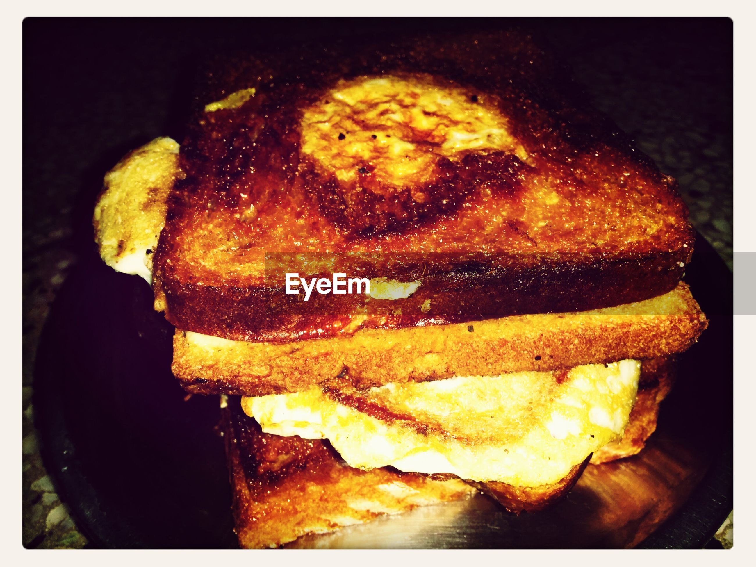 Close-up of grilled sandwich with omelet