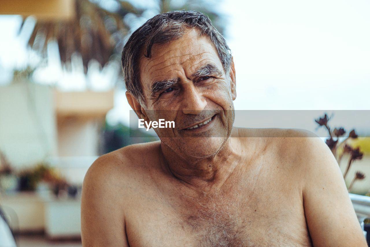 Portrait of shirtless mature man