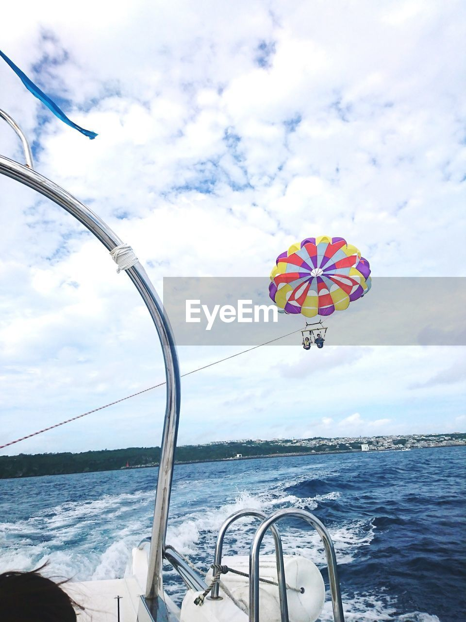 sea, cloud - sky, water, sky, transportation, mode of transport, horizon over water, day, multi colored, nature, nautical vessel, beauty in nature, flying, adventure, outdoors, scenics, no people, sailing, parachute