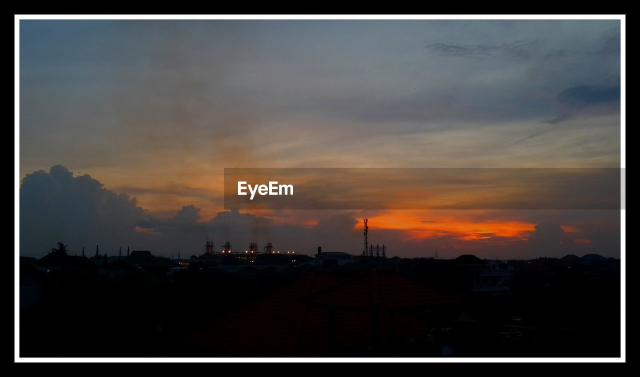 sunset, sky, silhouette, cloud - sky, architecture, building exterior, built structure, dramatic sky, no people, orange color, outdoors, scenics, nature, beauty in nature, city, electricity pylon, storm cloud, tree, day