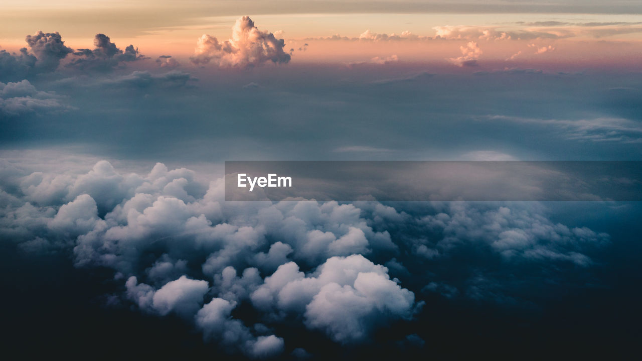 cloud - sky, sky, beauty in nature, scenics - nature, tranquility, sunset, tranquil scene, no people, nature, idyllic, outdoors, cloudscape, low angle view, orange color, white color, aerial view, full frame, backgrounds, day, meteorology