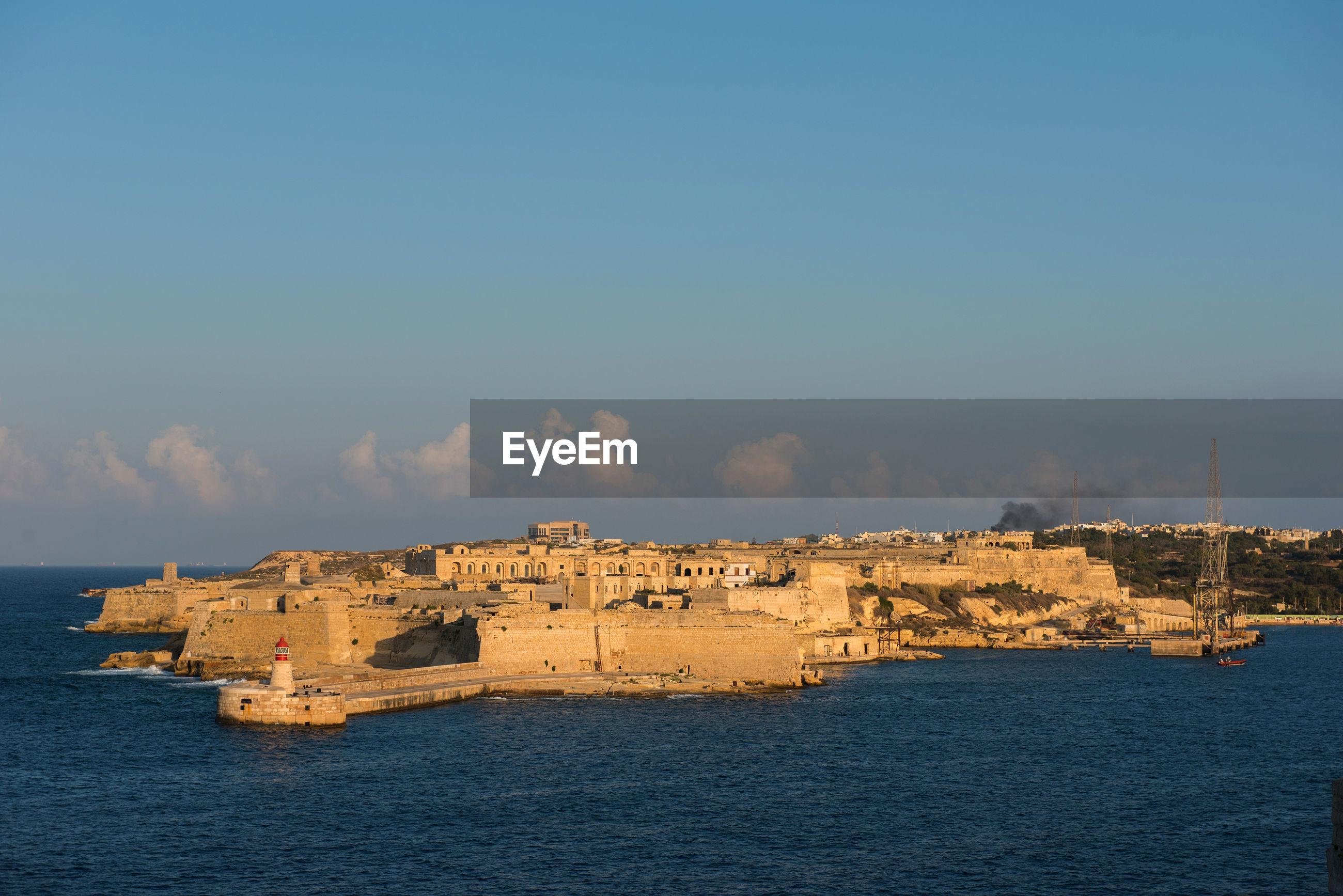 Fort on sea against blue sky