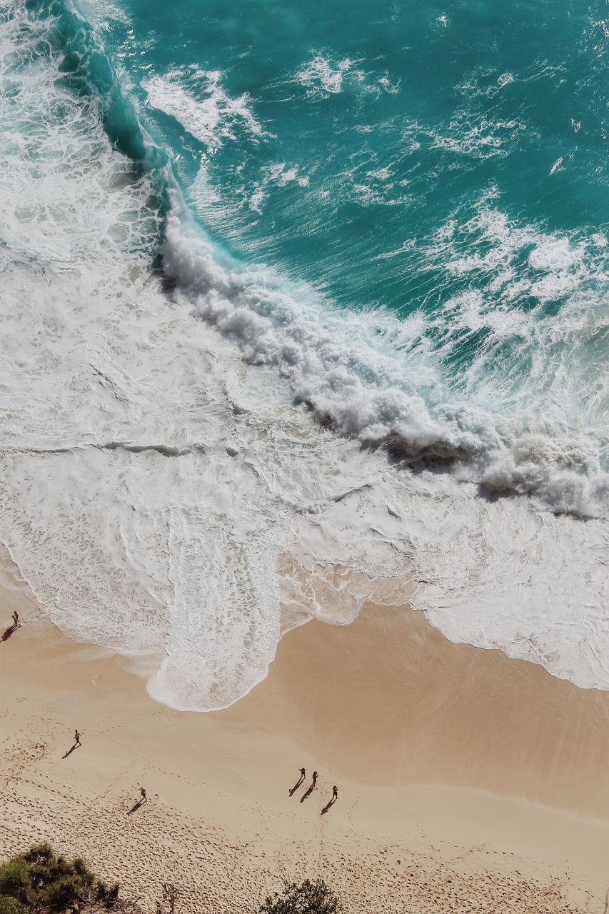 land, beach, sea, sand, water, aquatic sport, surfing, wave, sport, motion, beauty in nature, nature, people, high angle view, day, scenics - nature, hand, reaching, remote
