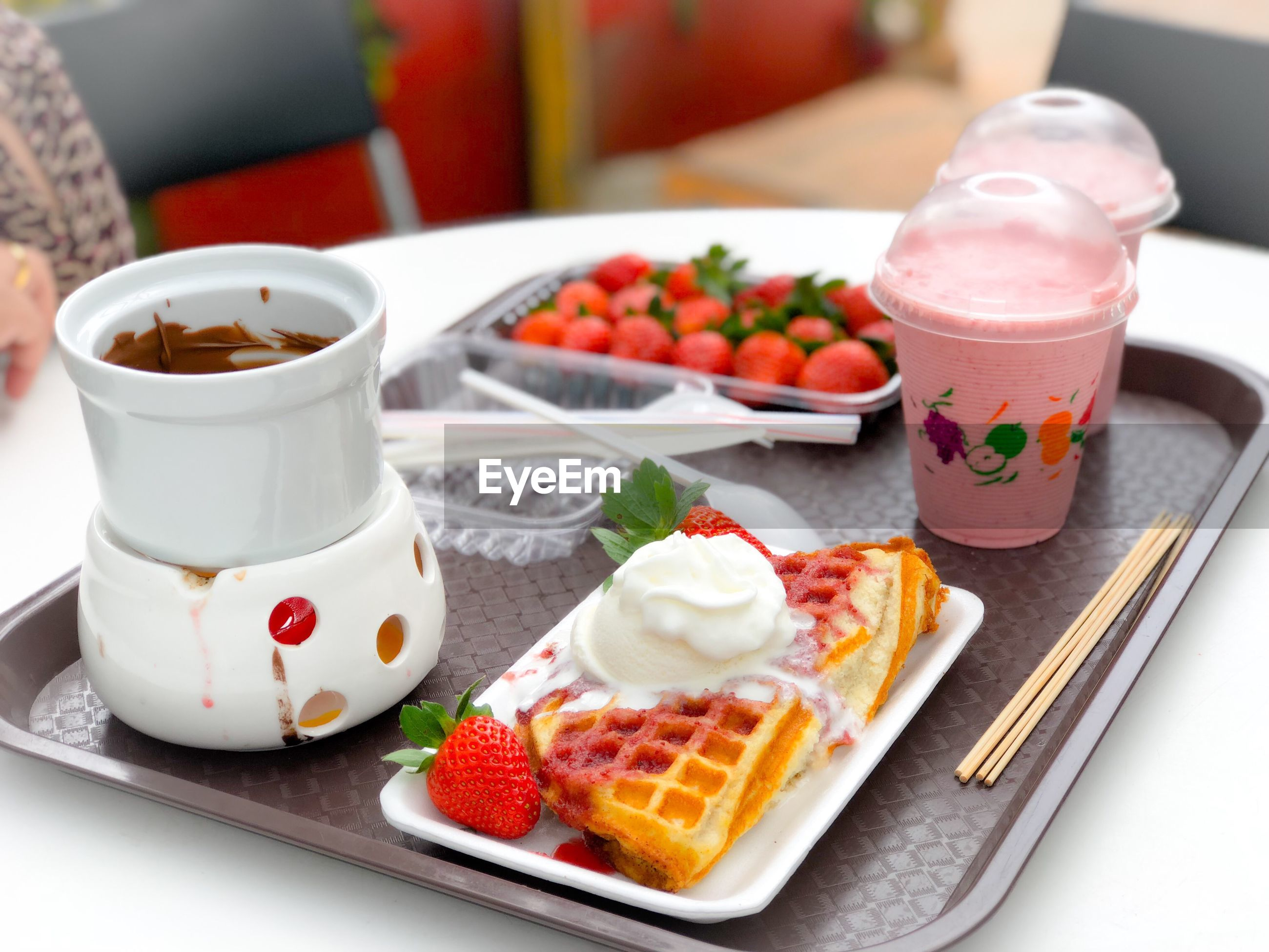 Food and drink in tray on table