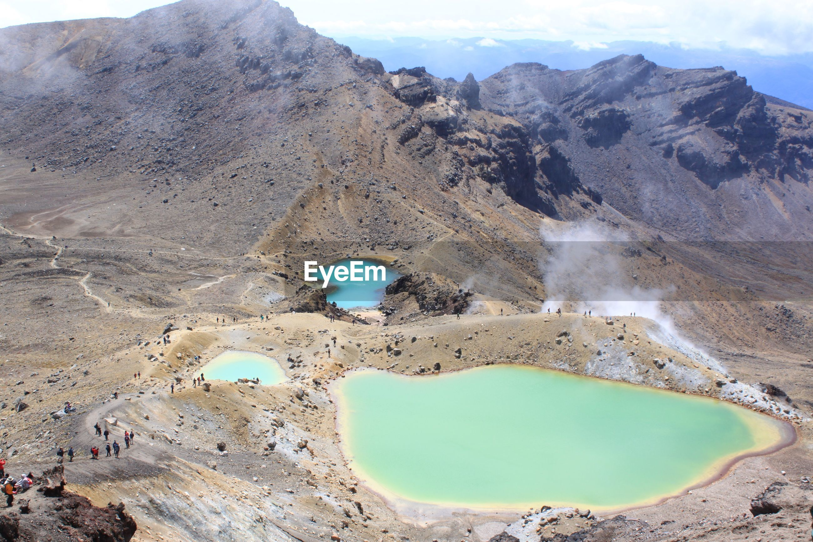 Scenic view of volcanic crater against sky